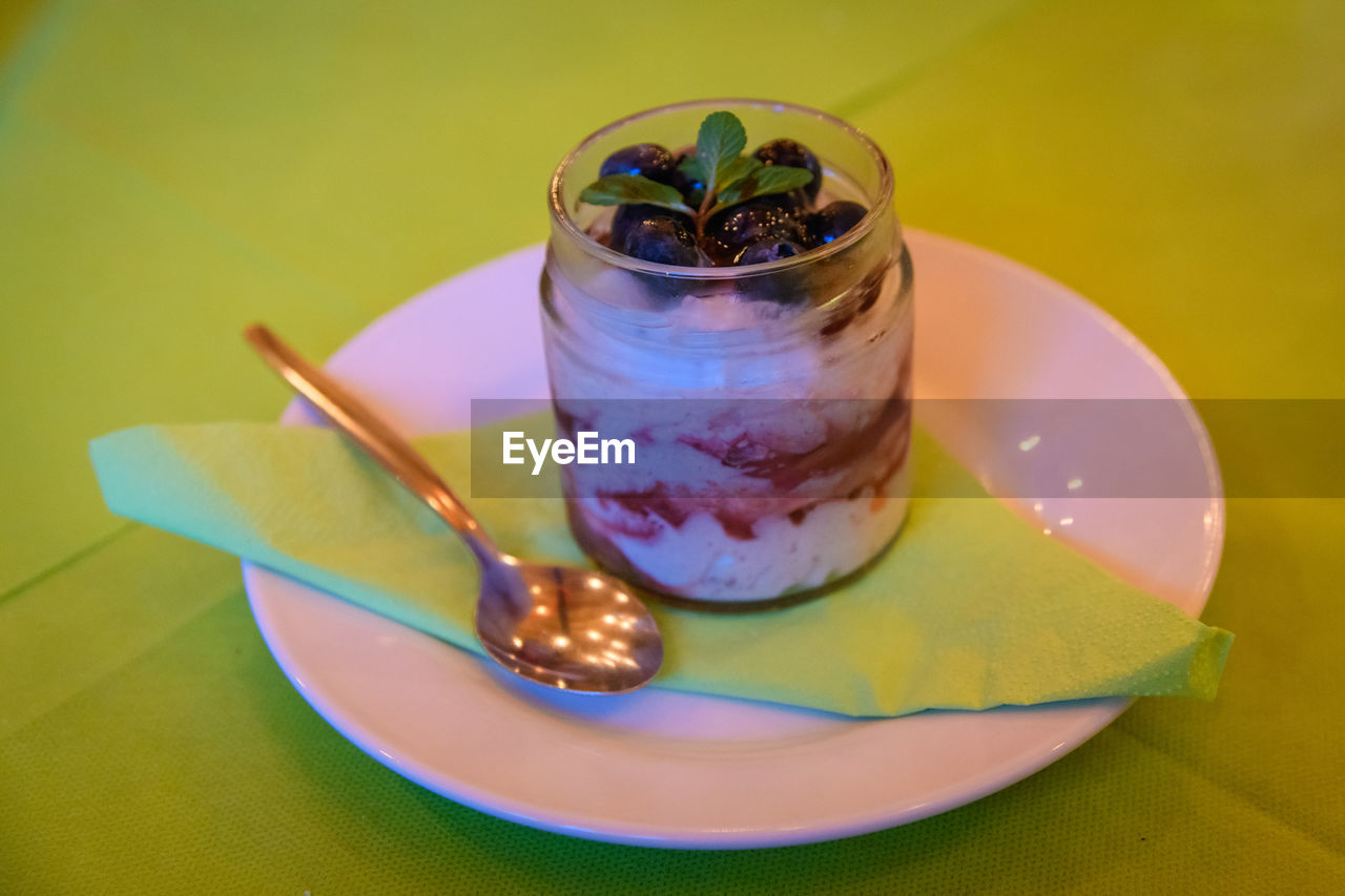 eating utensil, food, table, food and drink, spoon, kitchen utensil, freshness, fruit, plate, indoors, still life, ready-to-eat, close-up, no people, sweet food, healthy eating, dessert, sweet, indulgence, serving size, temptation, breakfast, purple