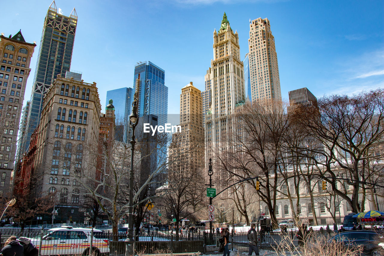 building exterior, built structure, architecture, building, city, office building exterior, skyscraper, sky, tower, tree, modern, cold temperature, winter, bare tree, nature, office, snow, tall - high, travel destinations, day, no people, outdoors, cityscape, financial district