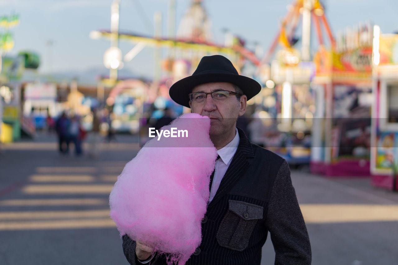 Man In Amusement Park