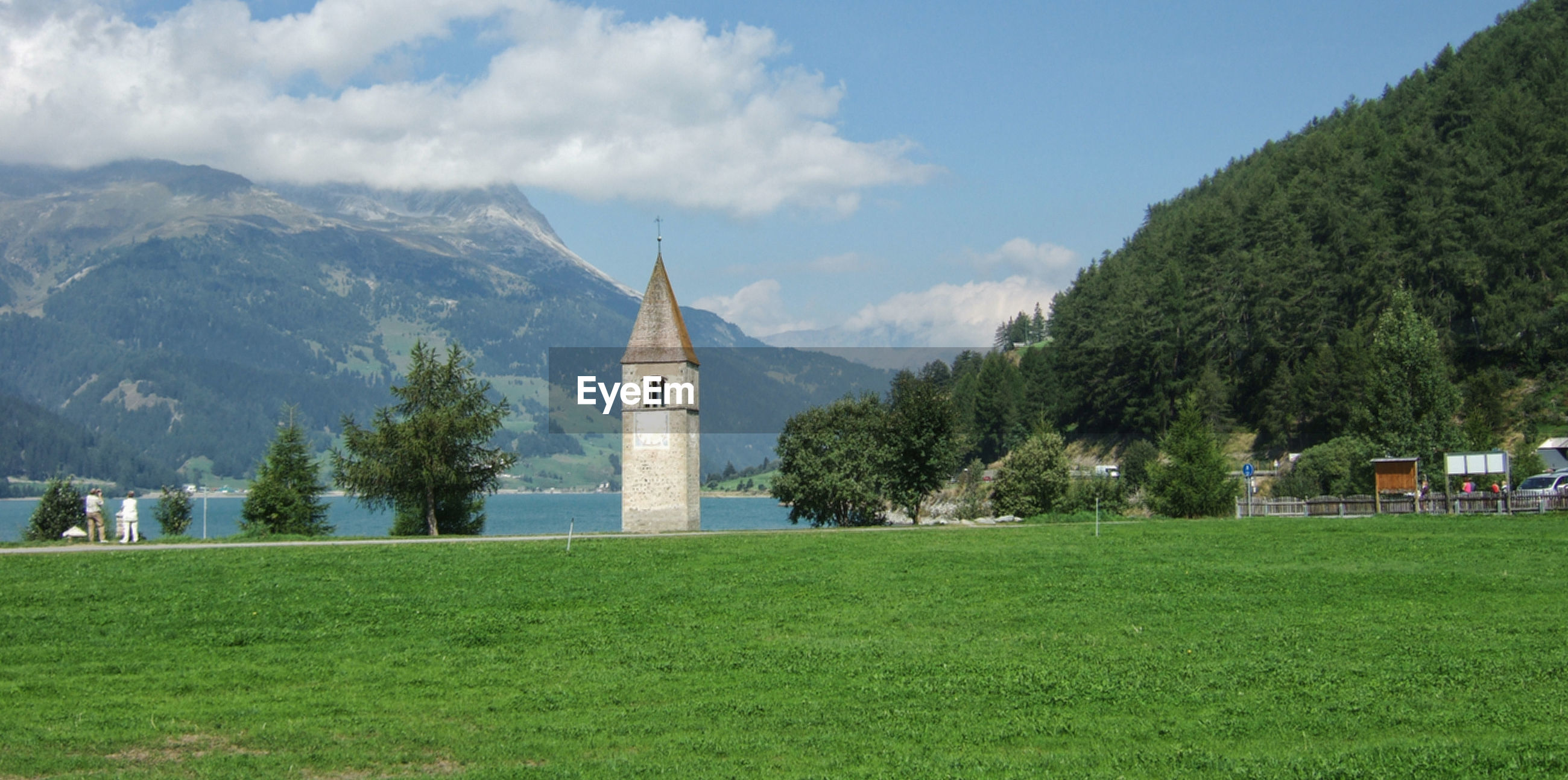 The bell tower of the former church of curon venosta in lake resia, south tyrol, italy.