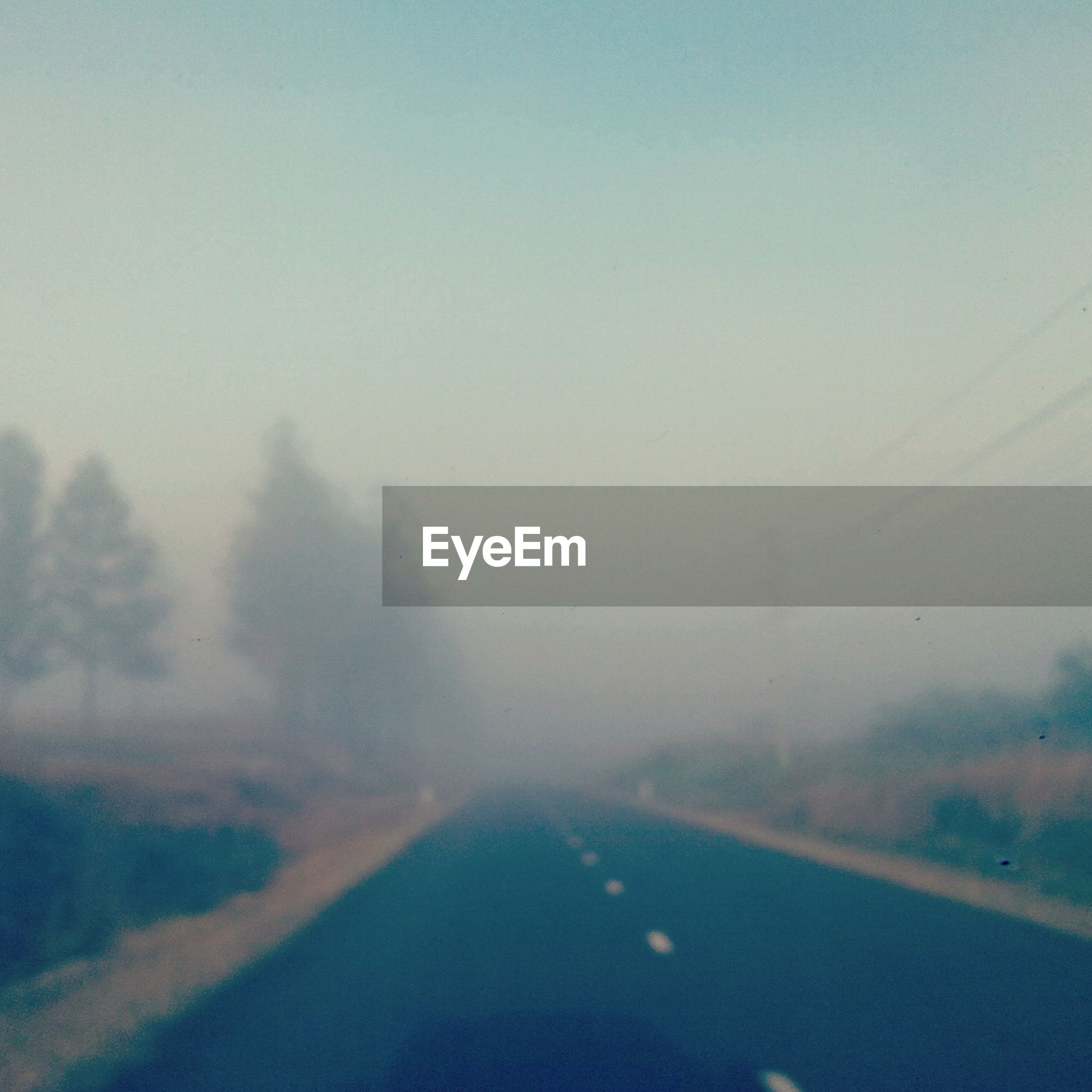 fog, weather, copy space, foggy, tranquility, transportation, scenics, landscape, tranquil scene, nature, beauty in nature, sky, road, no people, dusk, outdoors, day, season, idyllic