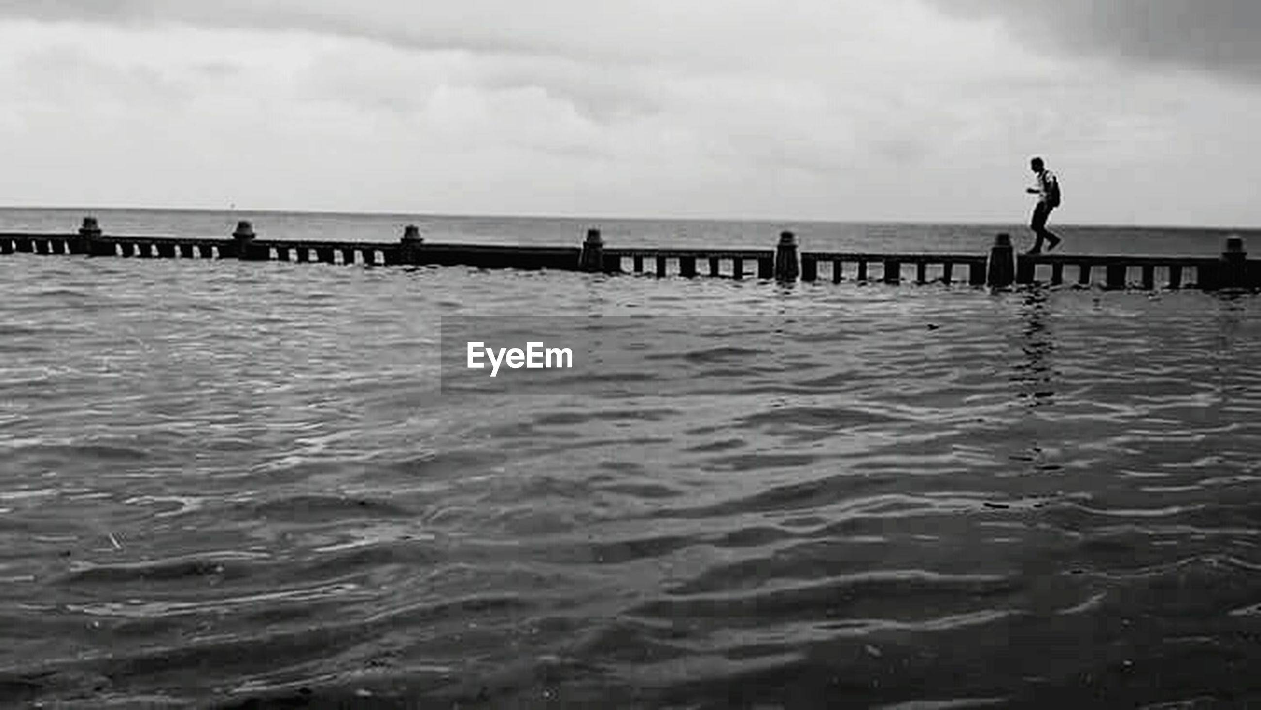 water, sea, sky, waterfront, rippled, pier, tranquility, tranquil scene, cloud - sky, scenics, nature, horizon over water, beauty in nature, cloud, silhouette, railing, cloudy, built structure, idyllic, bird