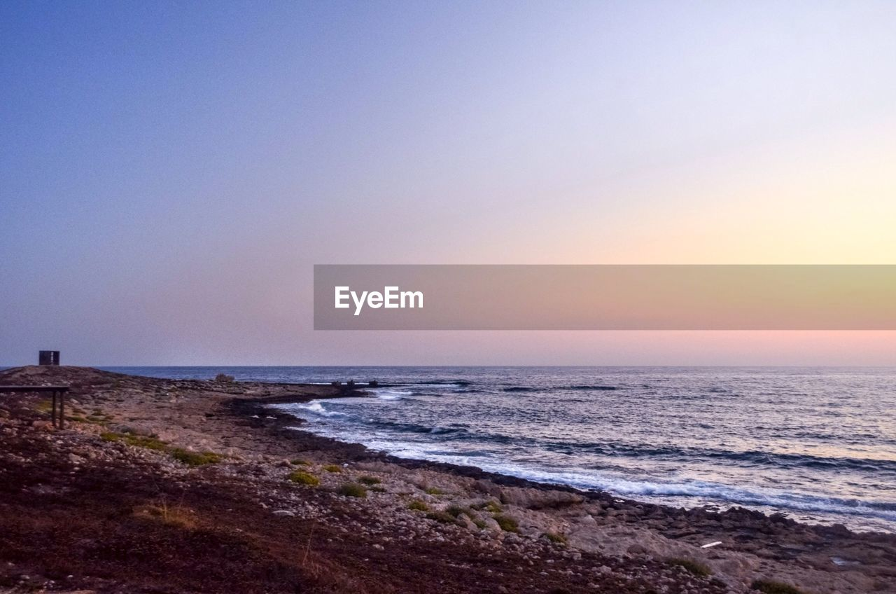 sea, nature, scenics, water, beauty in nature, sunset, horizon over water, tranquil scene, beach, tranquility, clear sky, outdoors, sky, wave, scenery, no people, day