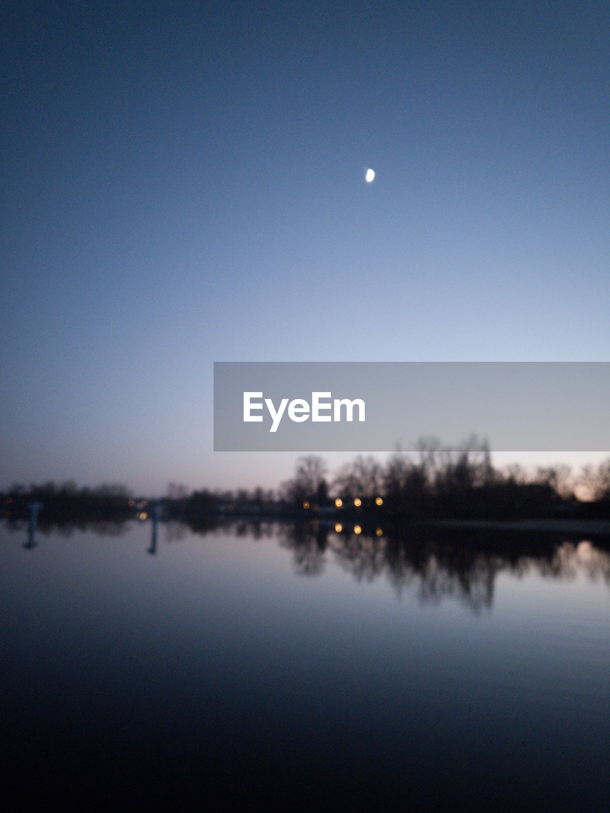 SCENIC VIEW OF LAKE AGAINST MOON AT NIGHT