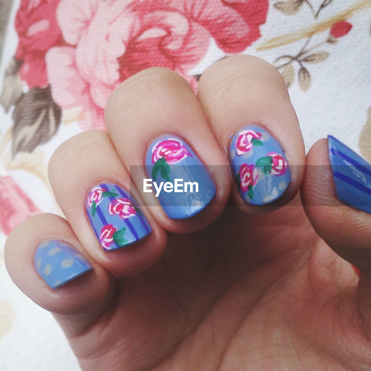 Cropped Image Of Woman Showing Nail Art