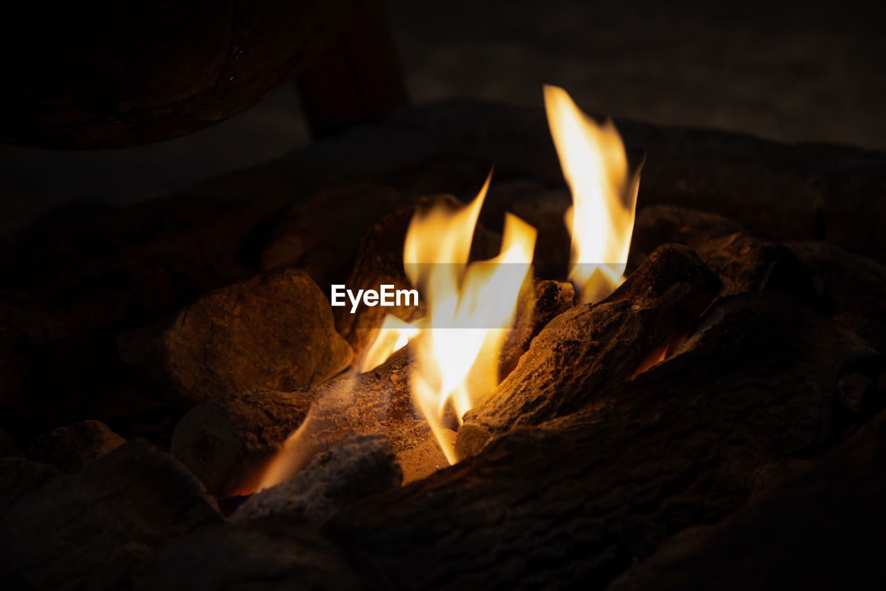 fire, burning, fire - natural phenomenon, flame, heat - temperature, nature, wood, log, wood - material, close-up, glowing, no people, orange color, night, firewood, motion, solid, rock, outdoors, dark, bonfire