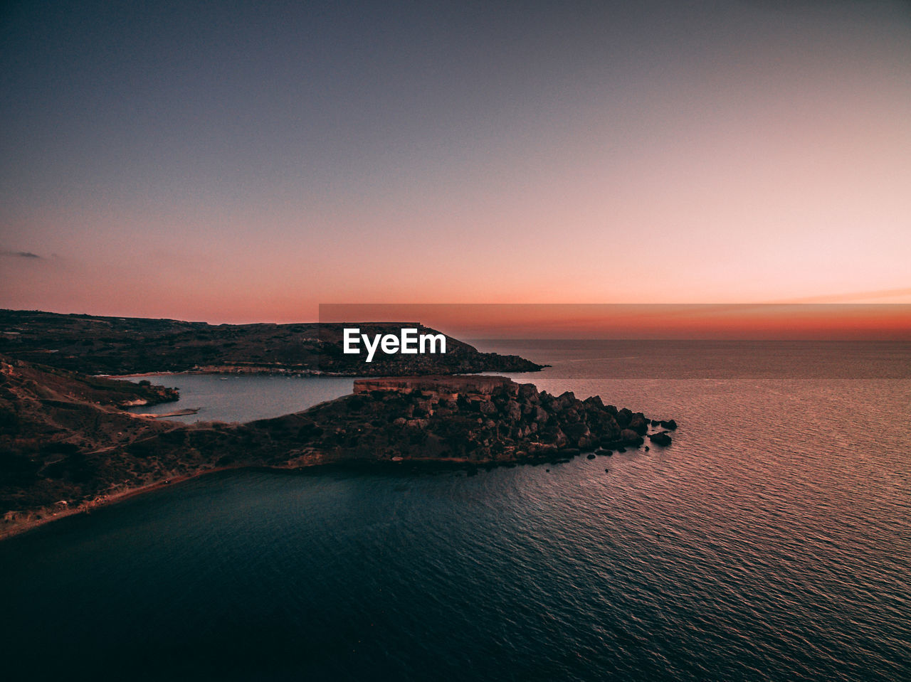 sea, water, sky, beauty in nature, scenics - nature, sunset, tranquil scene, tranquility, copy space, no people, nature, waterfront, idyllic, horizon over water, horizon, orange color, land, clear sky, architecture, outdoors