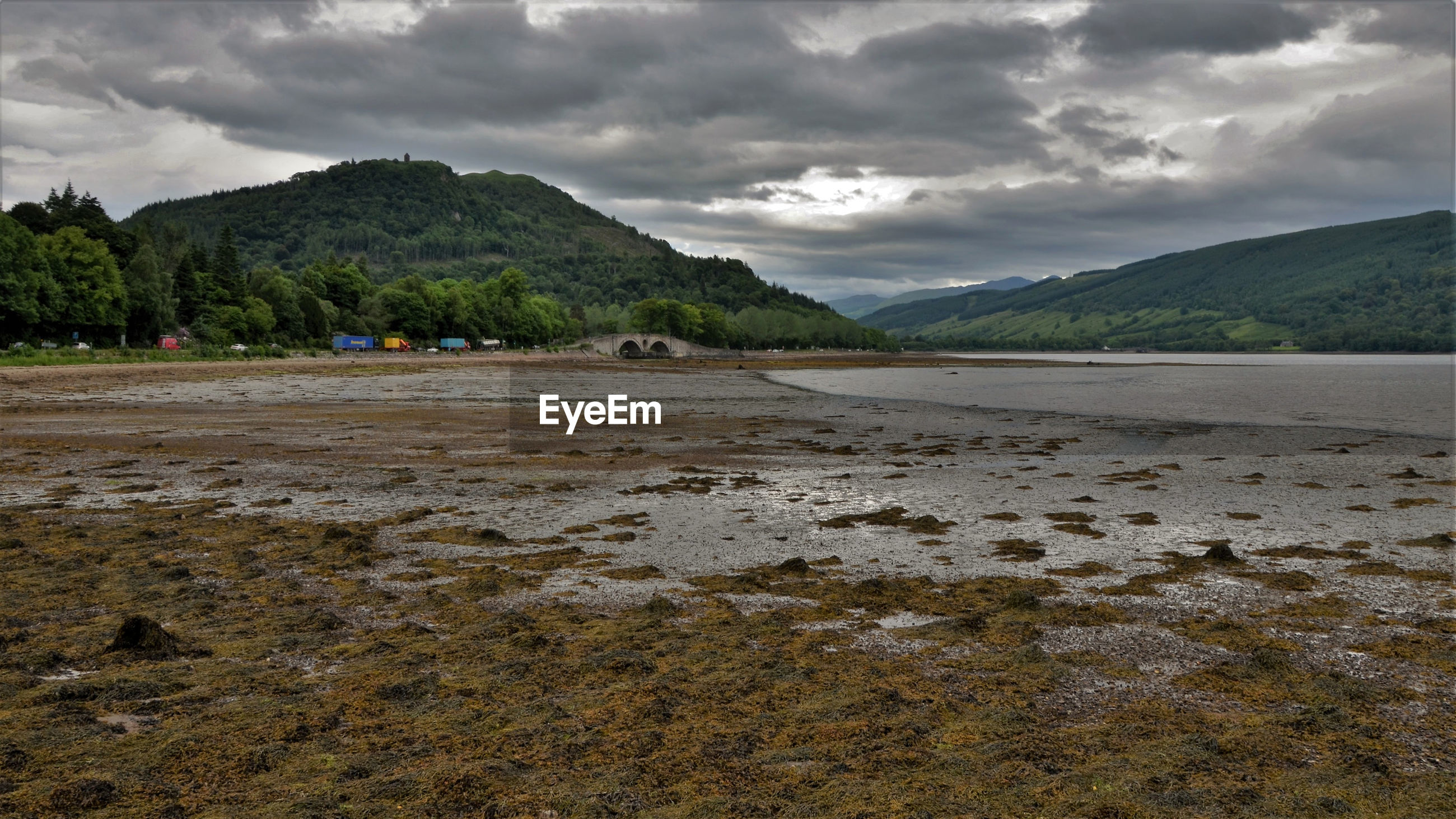 Scenic view of lake and mountains against cloudy sky, loch fyne, inveraray, scotland.
