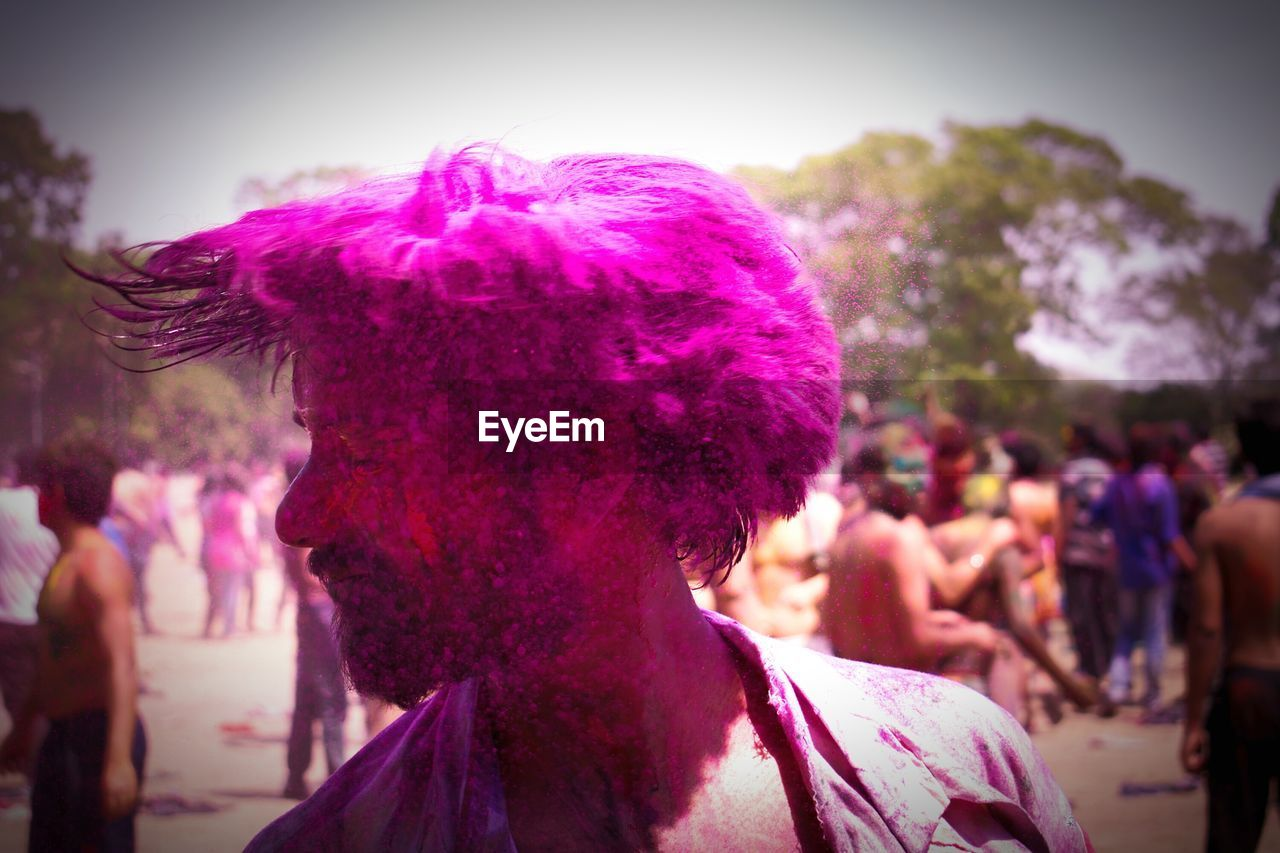 Man Tossing Hair With Powder Paint During Holi