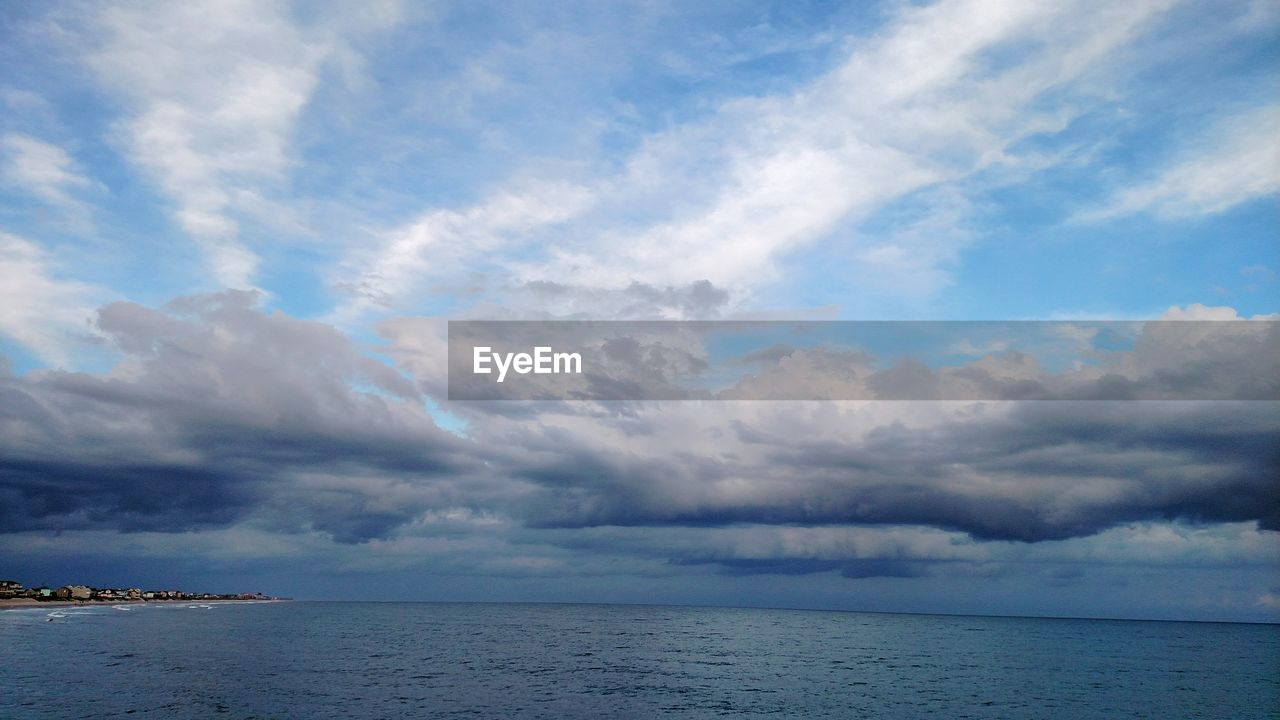 sea, sky, cloud - sky, horizon over water, scenics, water, tranquility, tranquil scene, beauty in nature, nature, idyllic, outdoors, no people, beach, day