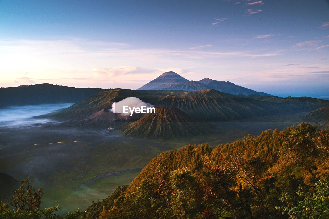 Scenic view of mount bromo against cloudy sky
