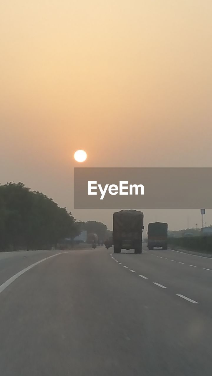 sunset, sun, orange color, road, sky, transportation, no people, nature, outdoors, scenics, clear sky, beauty in nature, built structure, architecture, day