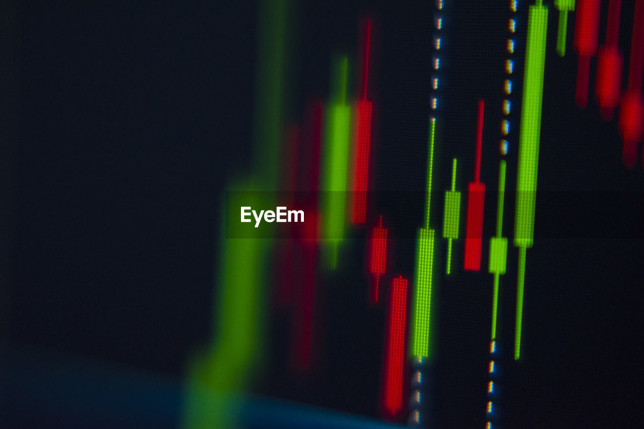 close-up, diagram, green color, number, multi colored, graph, business, black background, technology, no people, copy space, red, data, indoors, selective focus, studio shot, arts culture and entertainment, reflection, digital display, finance