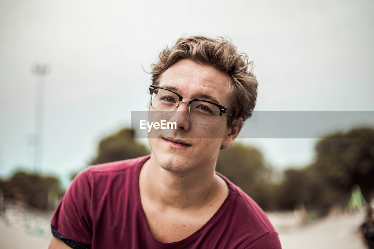 Close-Up Portrait Of Young Man Wearing Eyeglasses