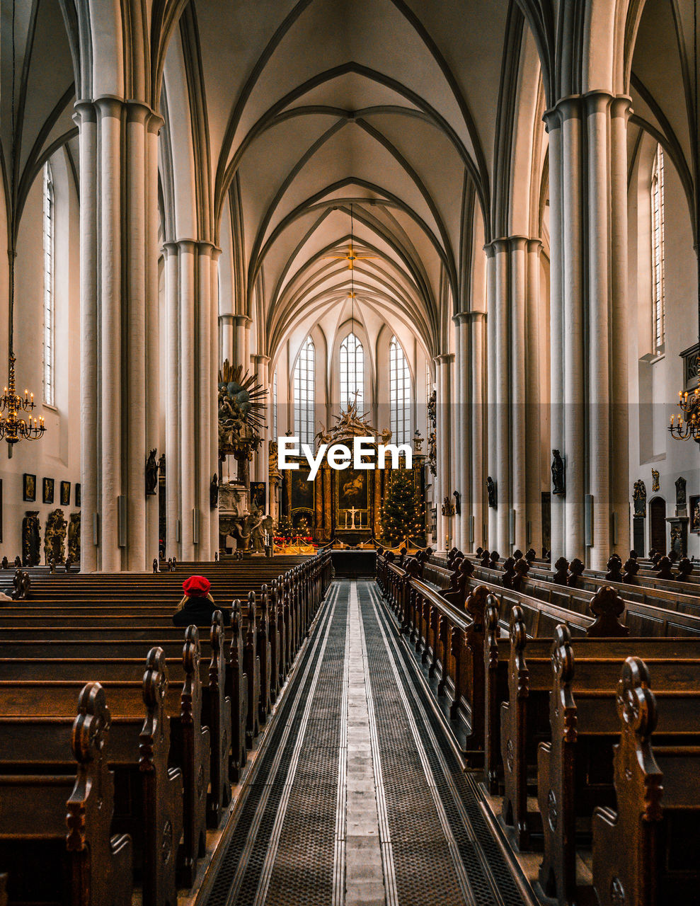 religion, place of worship, belief, pew, built structure, architecture, indoors, spirituality, building, in a row, arch, the way forward, architectural column, direction, bench, aisle, ceiling, abbey, gothic style
