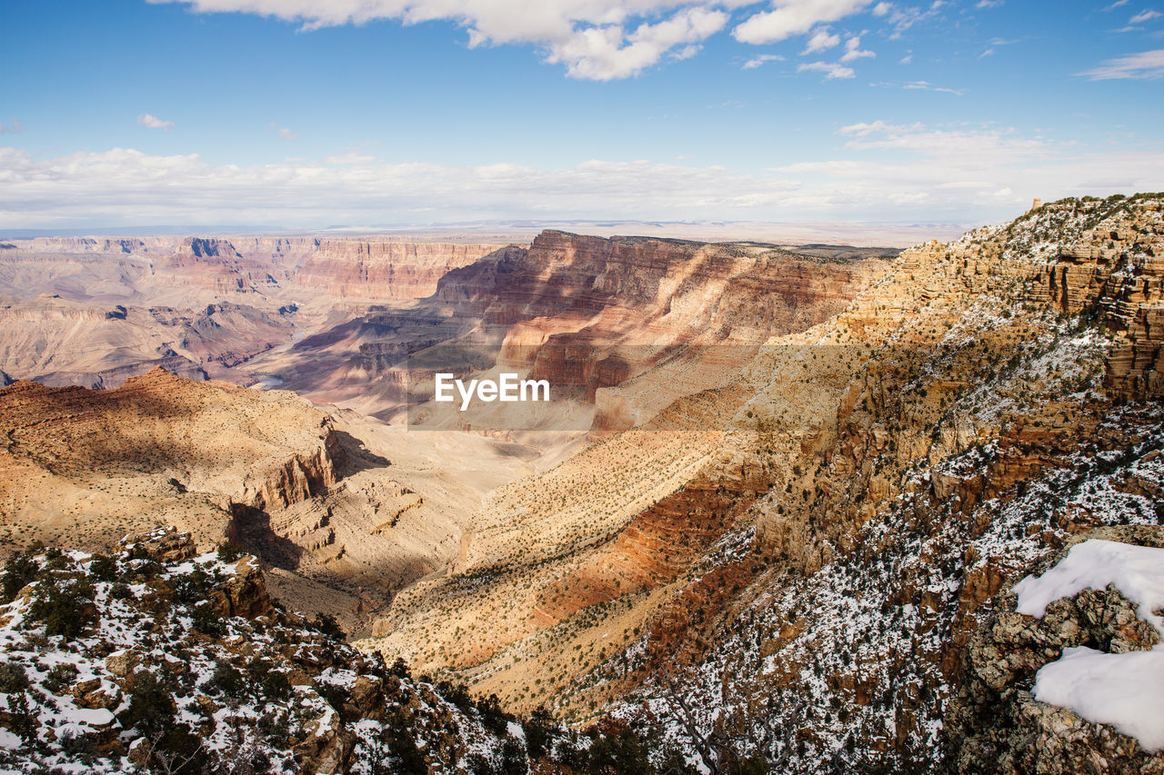 Scenic View Of Rocky Mountains Against Sky In Grand Canyon National Park