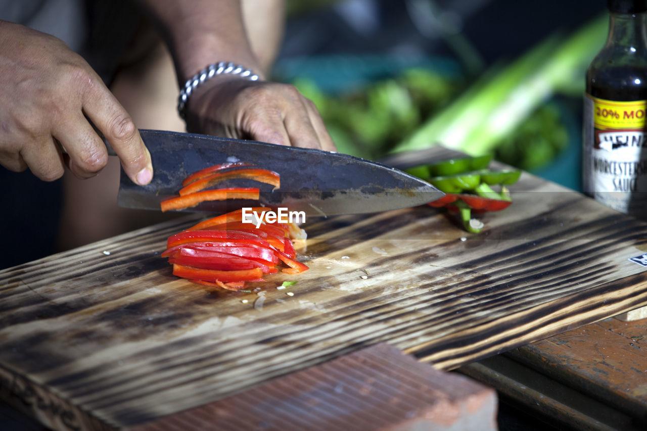 Man chopping bell pepper