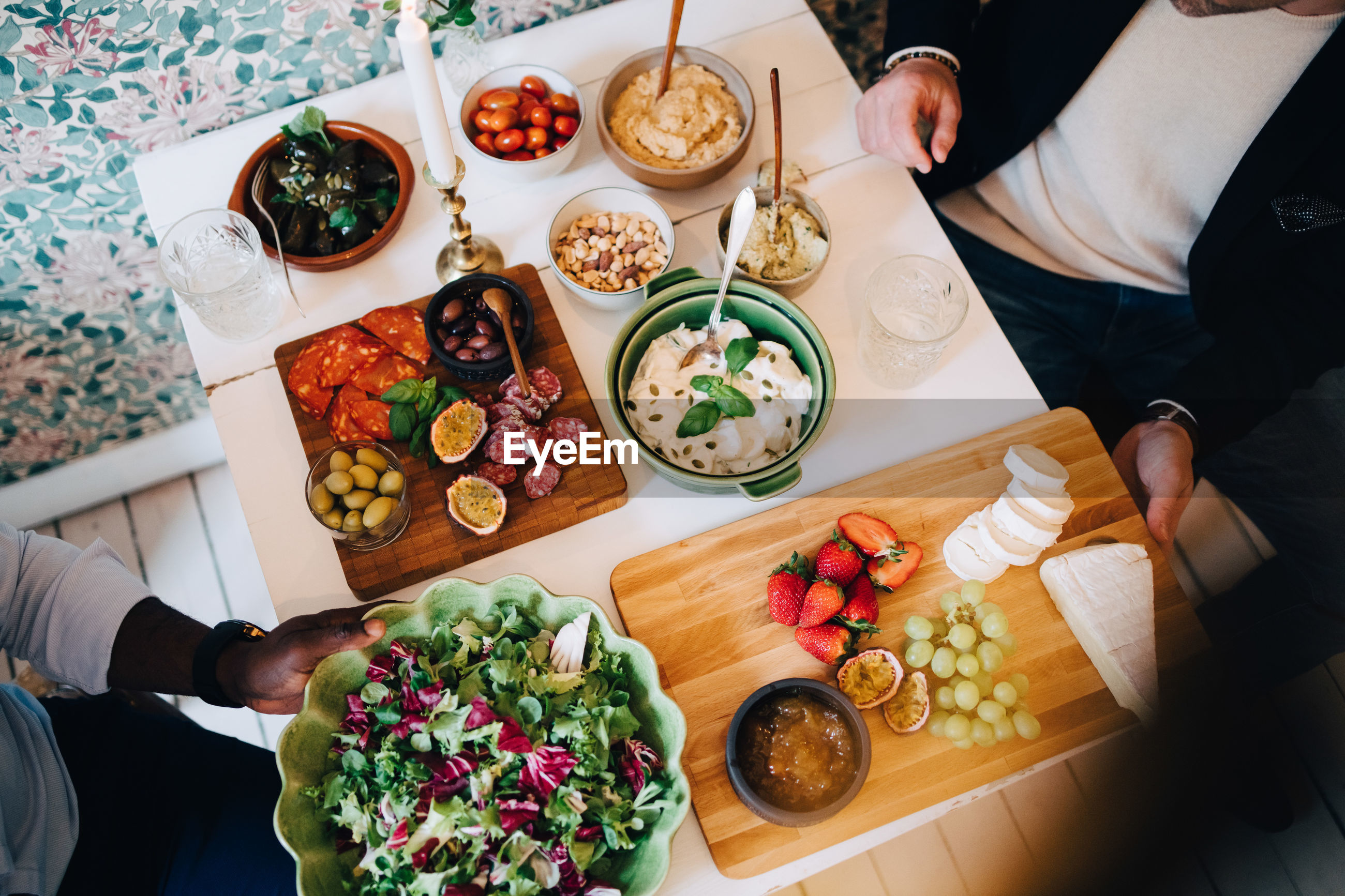 Directly above shot of friends having healthy food at table