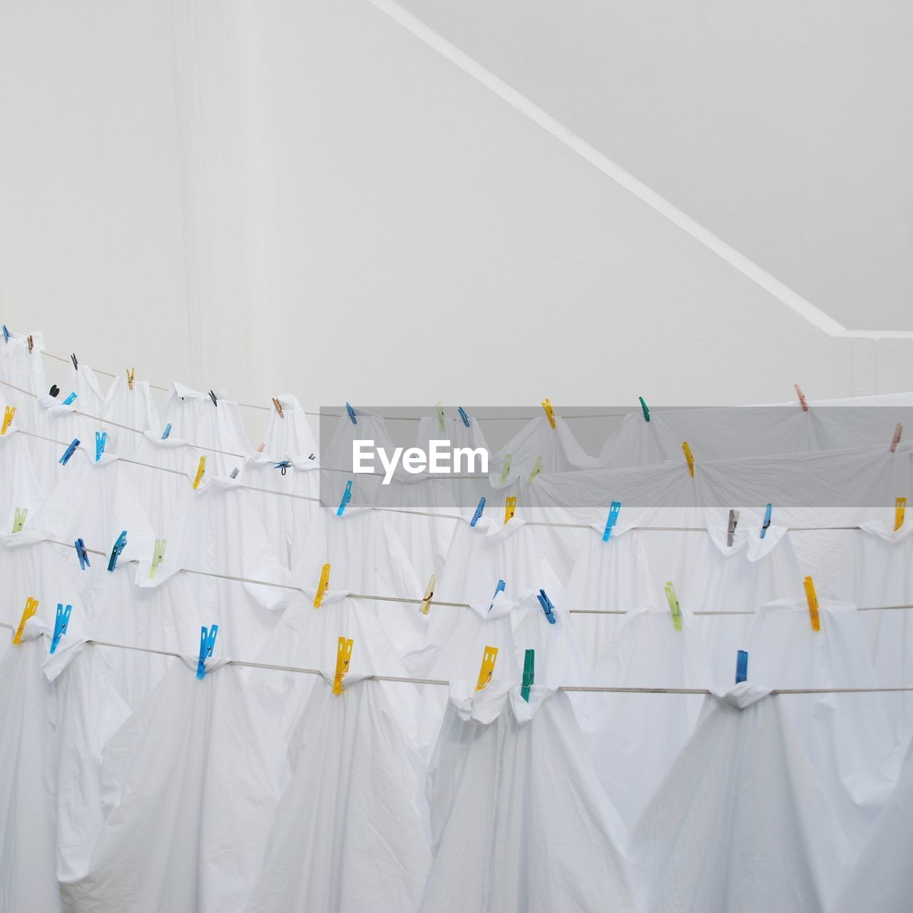 White is my colour / white linen hanging on pegs