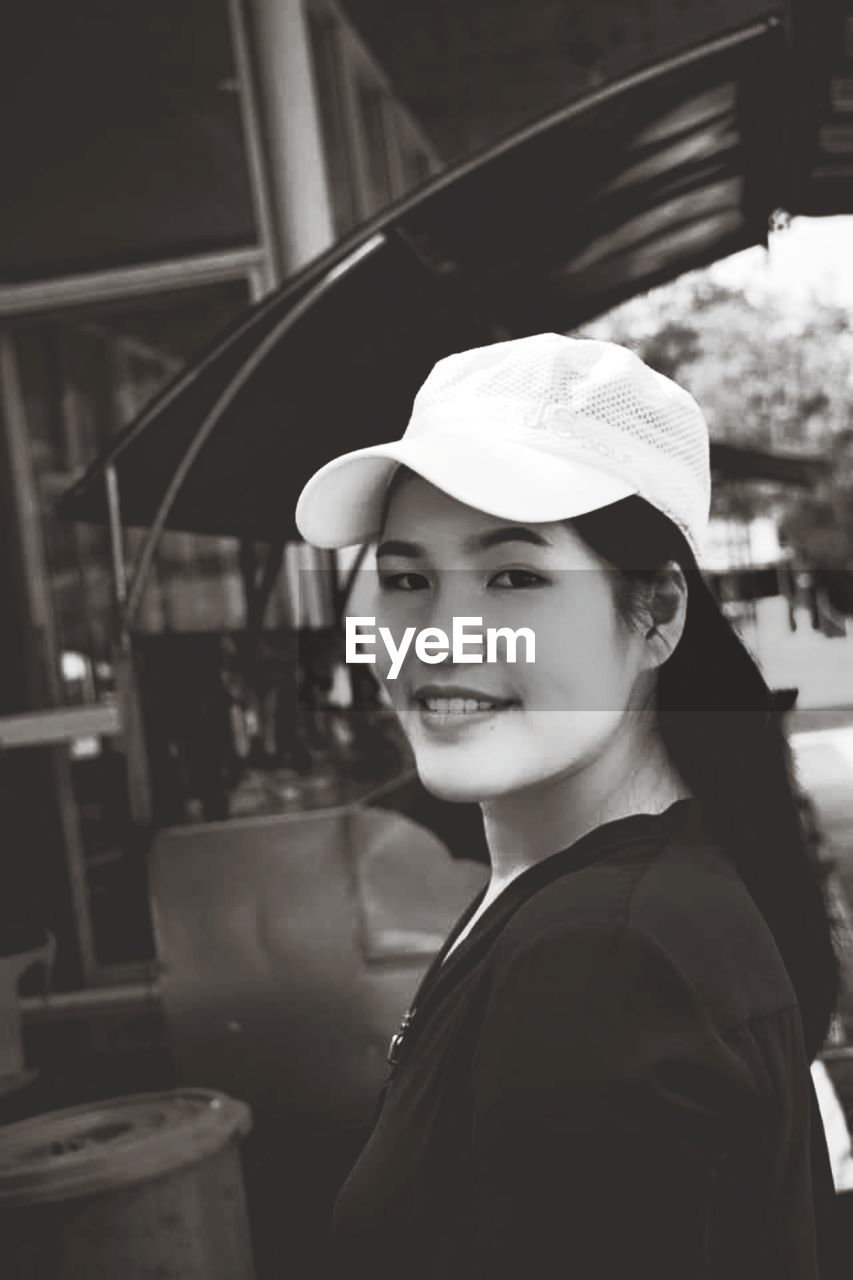 Portrait of smiling woman wearing cap
