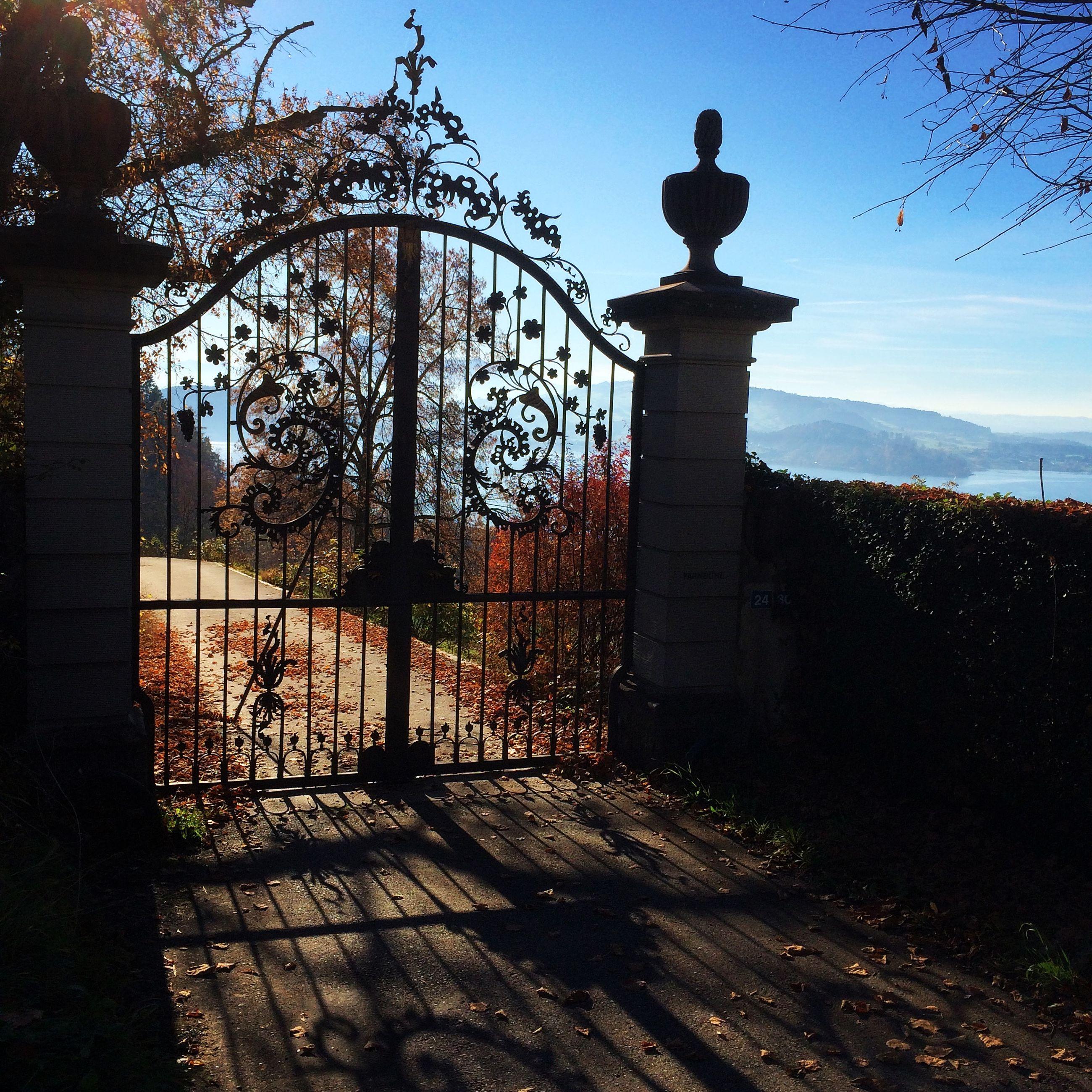 Closed gate against blue sky