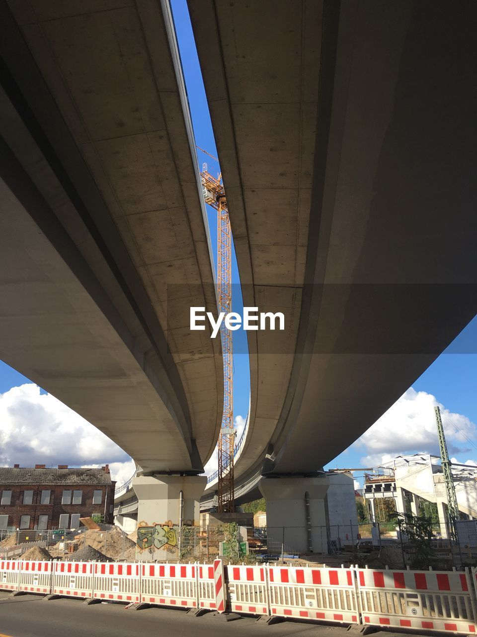 built structure, architecture, transportation, building exterior, connection, bridge, city, bridge - man made structure, day, road, low angle view, architectural column, nature, sky, no people, building, travel destinations, street, outdoors