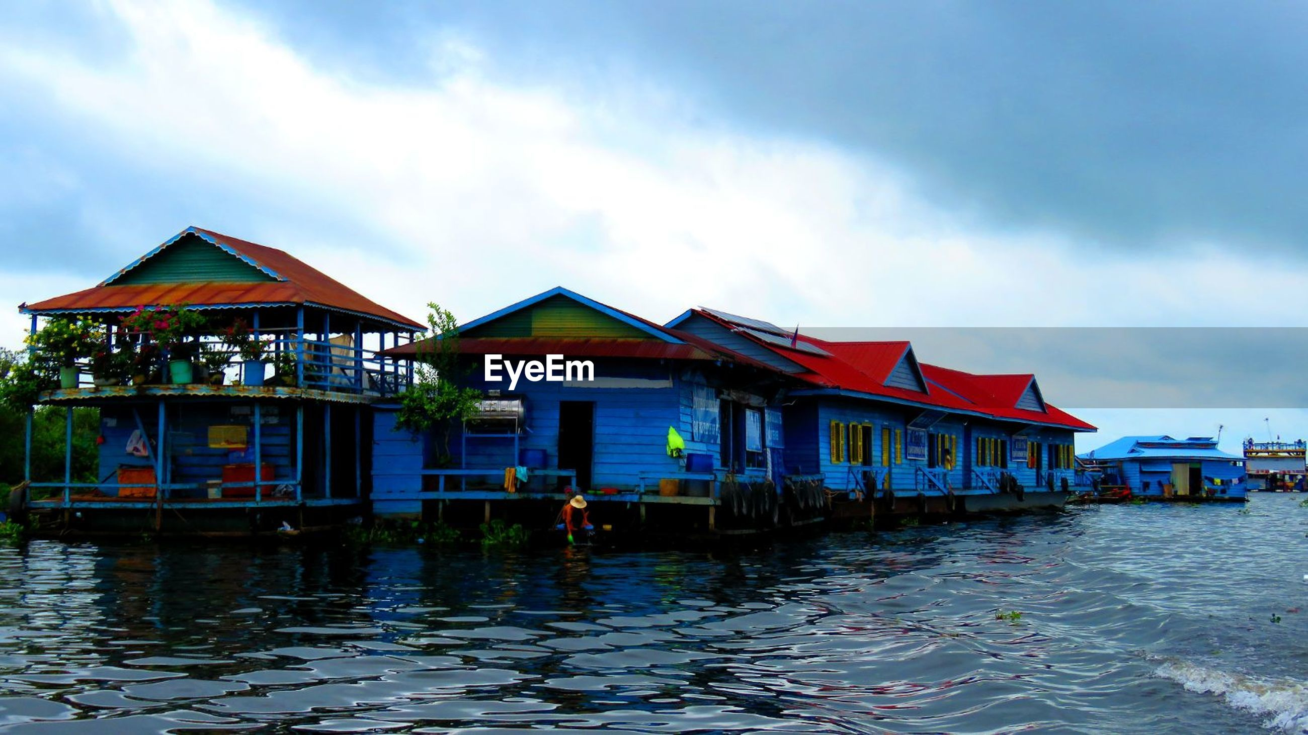 built structure, architecture, water, sky, waterfront, building exterior, cloud - sky, rippled, day, stilt house, tranquility, outdoors, tranquil scene, no people, nature