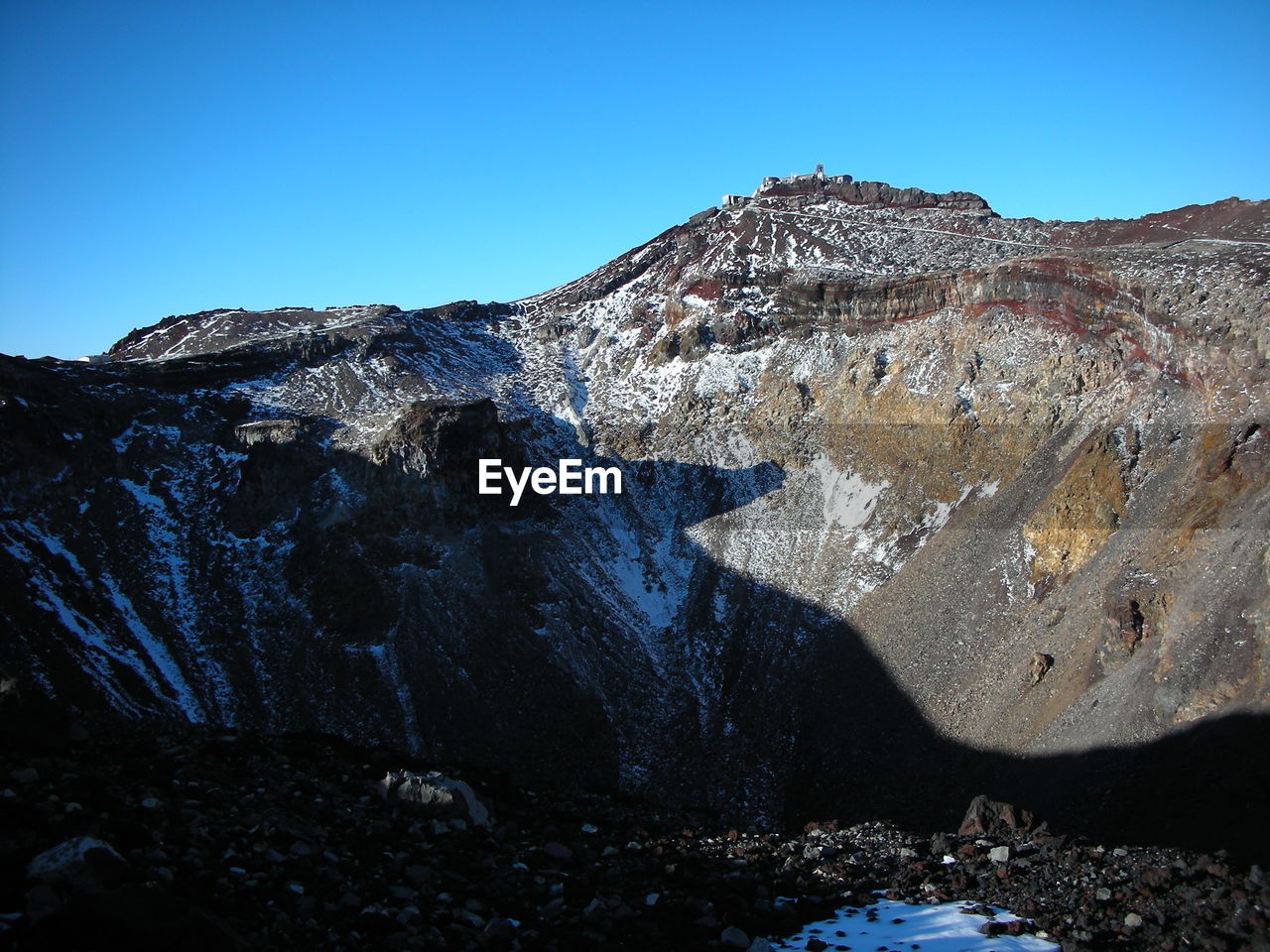 sky, clear sky, rock, mountain, nature, beauty in nature, tranquil scene, solid, scenics - nature, rock - object, blue, tranquility, no people, day, rock formation, non-urban scene, physical geography, sunlight, geology, land, mountain range, outdoors, formation, eroded, mountain peak, volcanic crater
