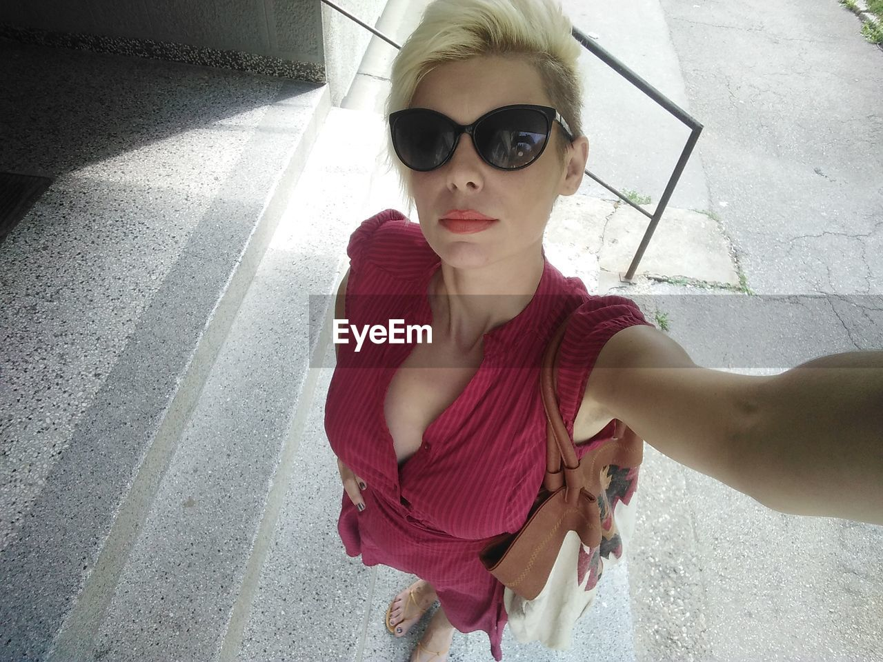 High angle portrait of woman wearing sunglasses