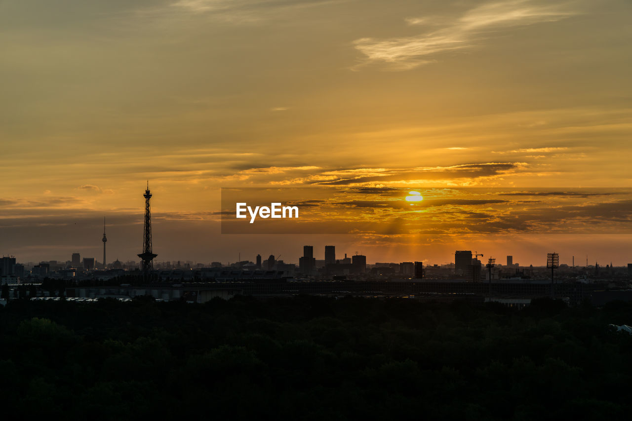 sunset, architecture, built structure, sky, building exterior, travel destinations, tower, tall - high, orange color, city, silhouette, sun, cloud - sky, cityscape, no people, tourism, outdoors, skyscraper, nature, beauty in nature