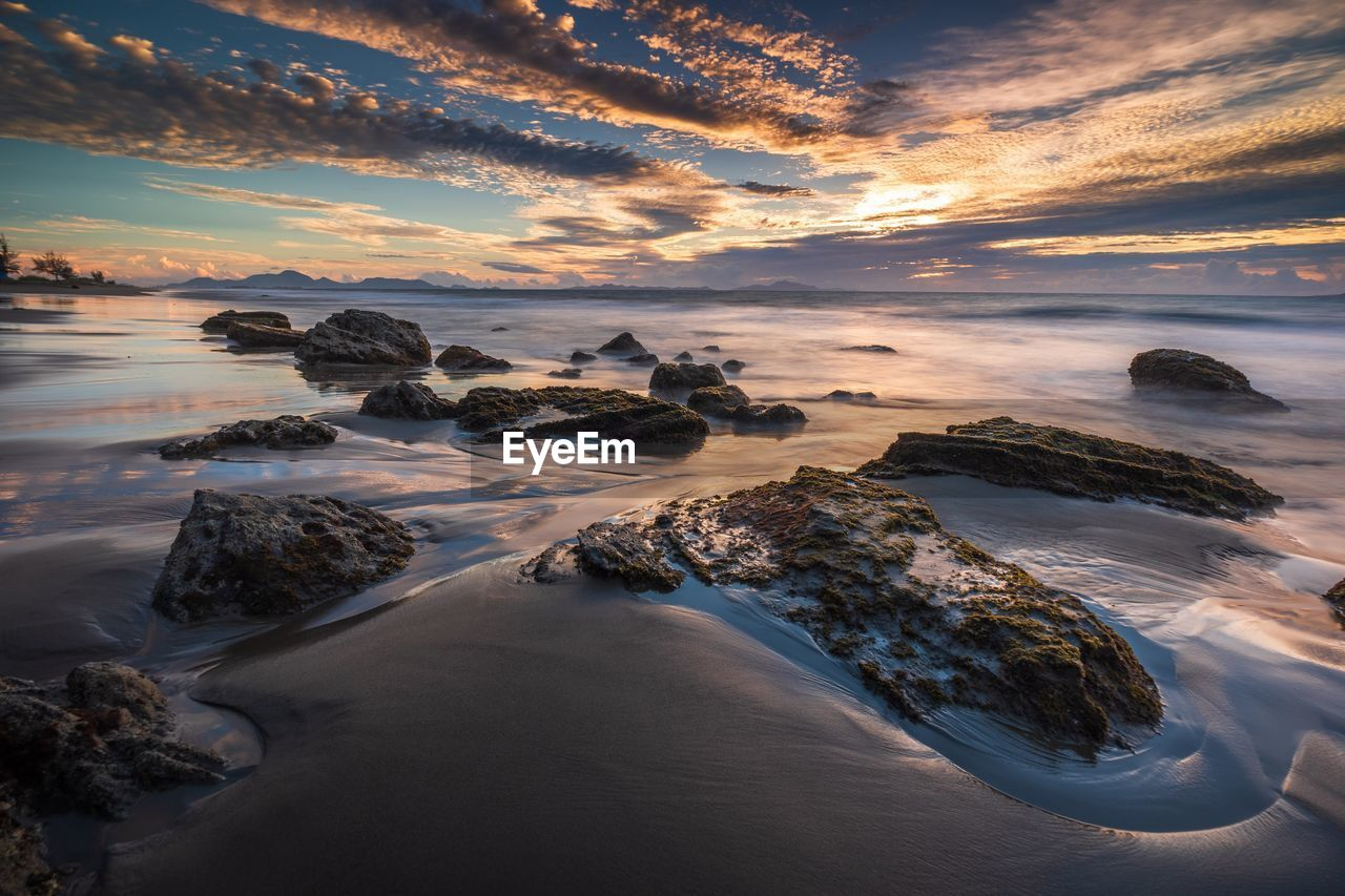 sky, cloud - sky, sunset, beauty in nature, water, scenics - nature, sea, tranquil scene, tranquility, rock, idyllic, land, horizon over water, no people, beach, rock - object, horizon, nature, solid