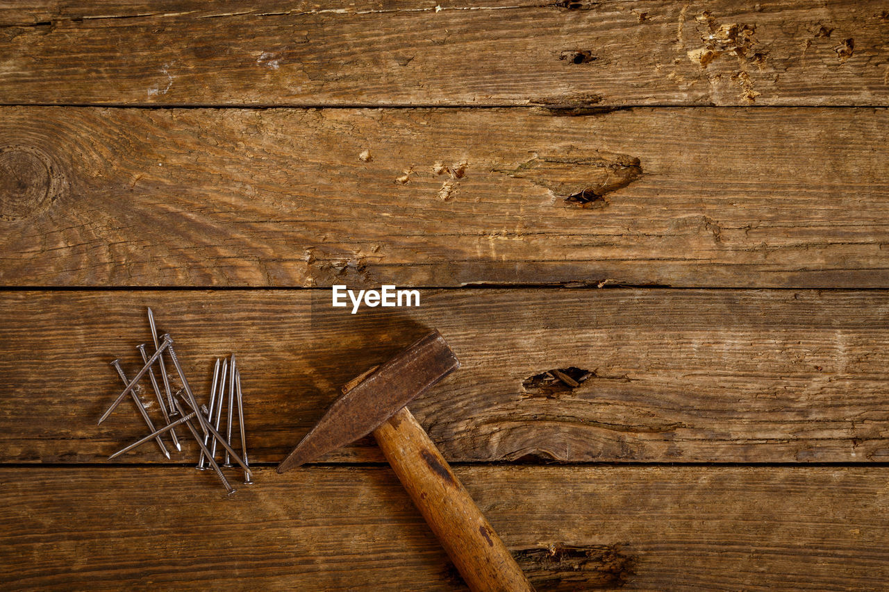 wood - material, indoors, plank, brown, no people, wood, textured, backgrounds, directly above, old, studio shot, copy space, wood grain, carpentry, food and drink, high angle view, colored background, rough, timber
