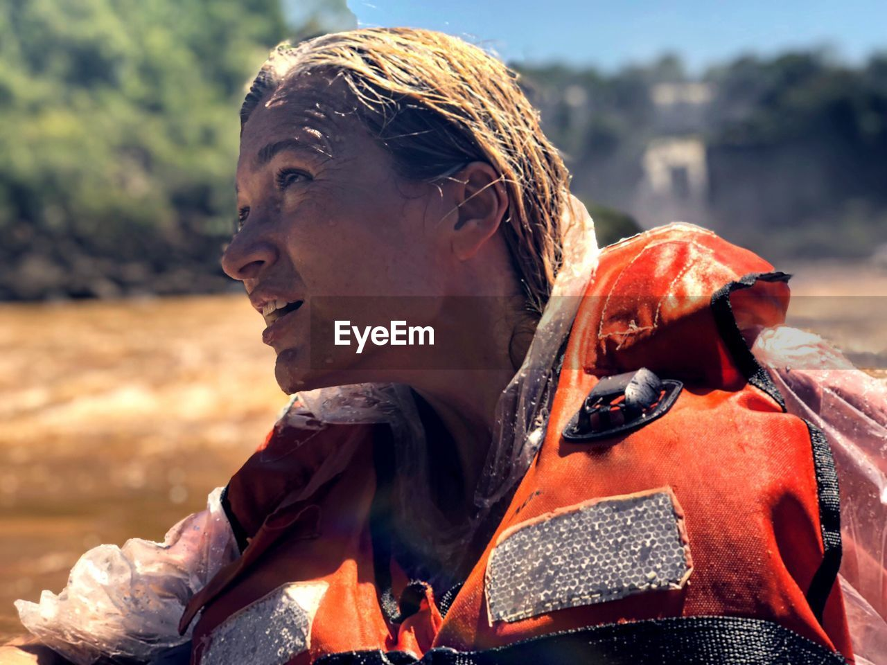 Close-up of woman looking away while rafting