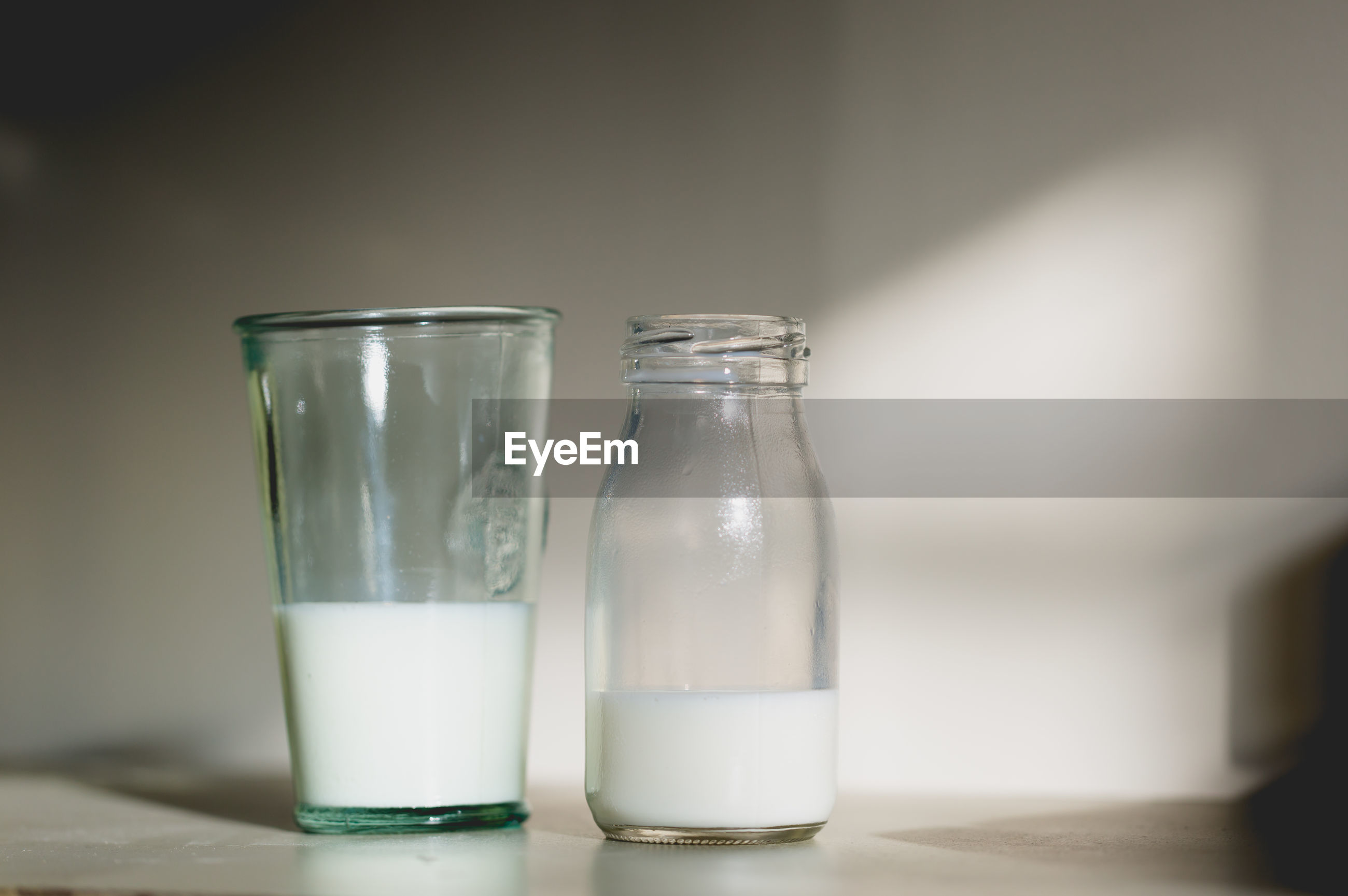 Close-up of milk in glass and bottle