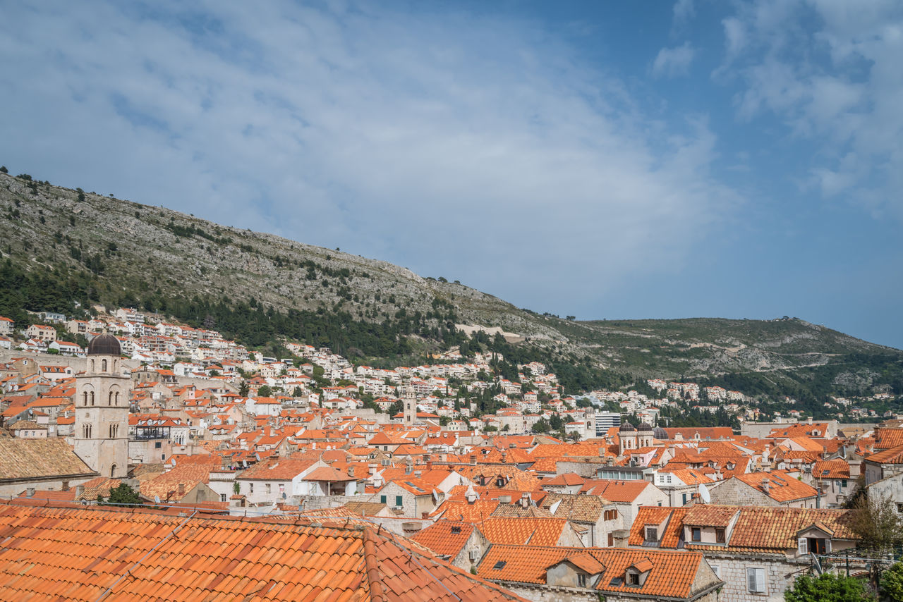 architecture, building, building exterior, built structure, roof, sky, cloud - sky, city, residential district, house, nature, town, day, no people, outdoors, mountain, high angle view, roof tile, townscape