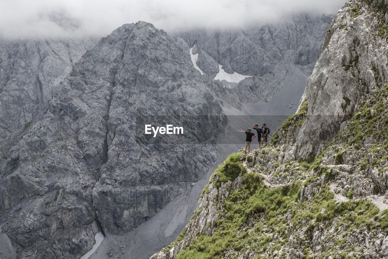 Hikers standing at the edge of ehrwalder sonnenspitze