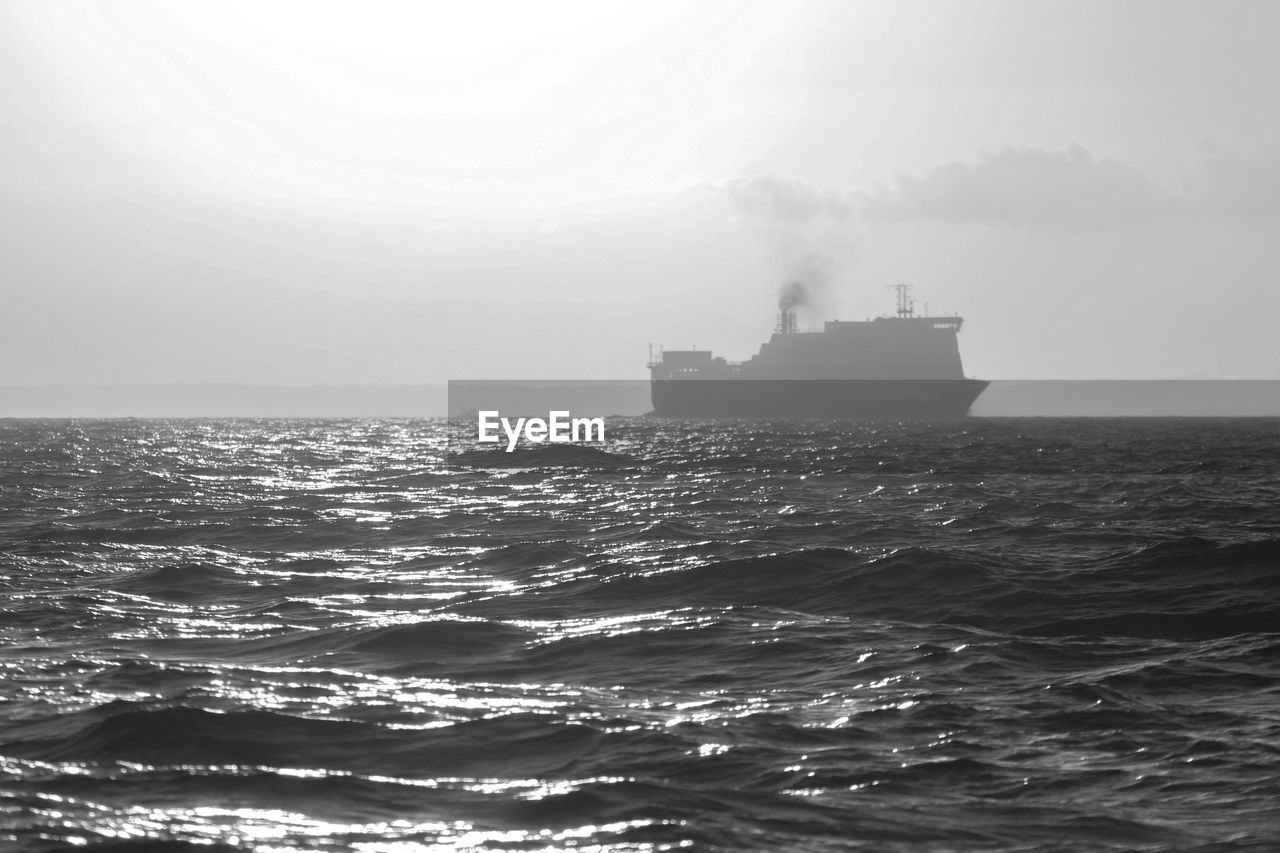 sea, water, sky, ship, nautical vessel, horizon over water, horizon, nature, motion, no people, waterfront, wave, transportation, scenics - nature, mode of transportation, day, outdoors, beauty in nature, shipping, pollution, passenger craft