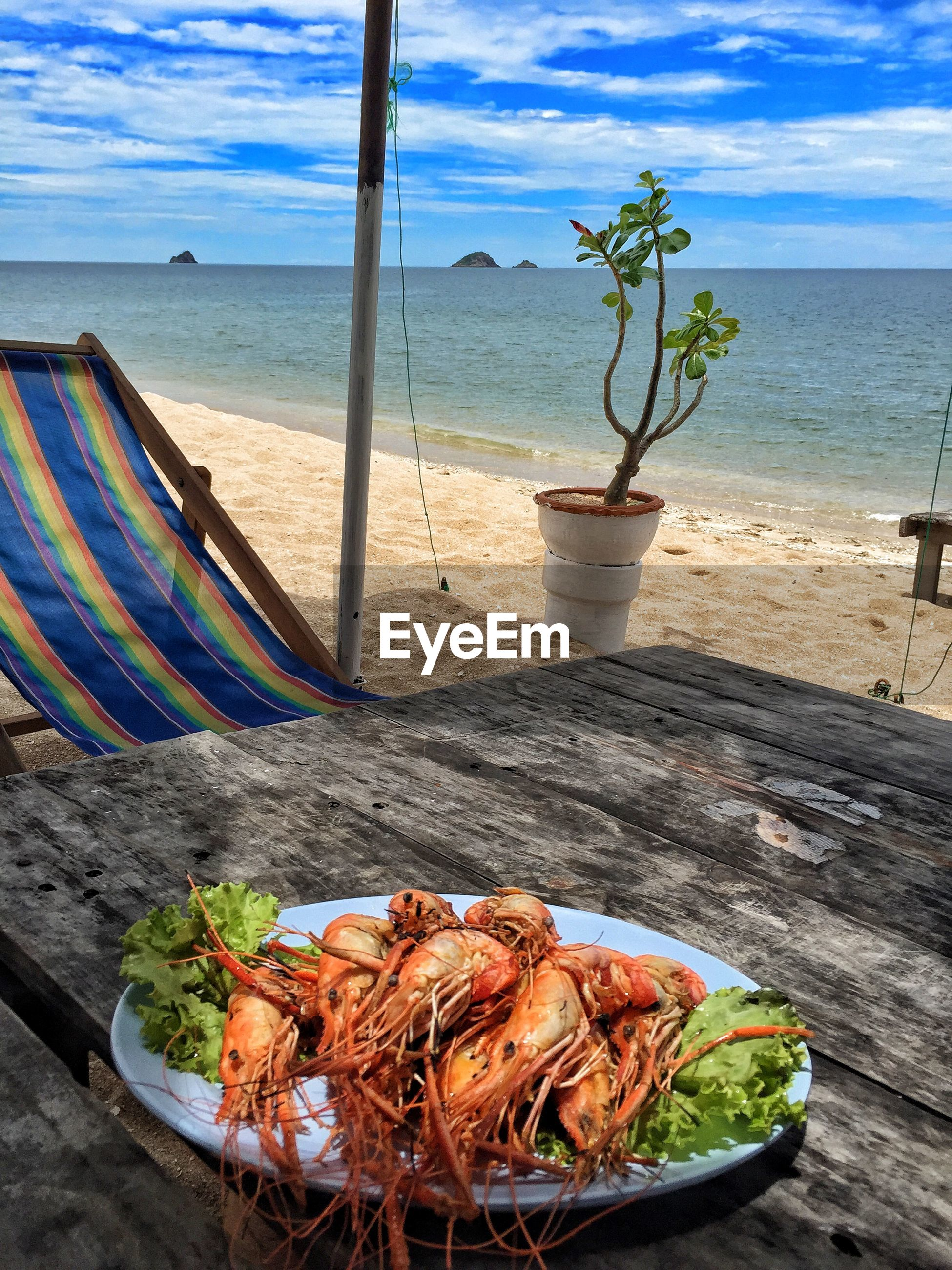 Fresh shrimps served in plate on table at sai noi beach