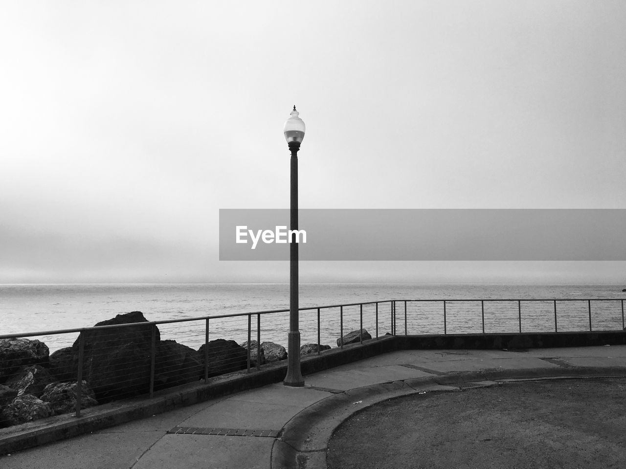 water, sea, railing, tranquil scene, travel destinations, horizon over water, street light, tranquility, scenics, built structure, day, nature, no people, architecture, outdoors, sky, clear sky, beauty in nature