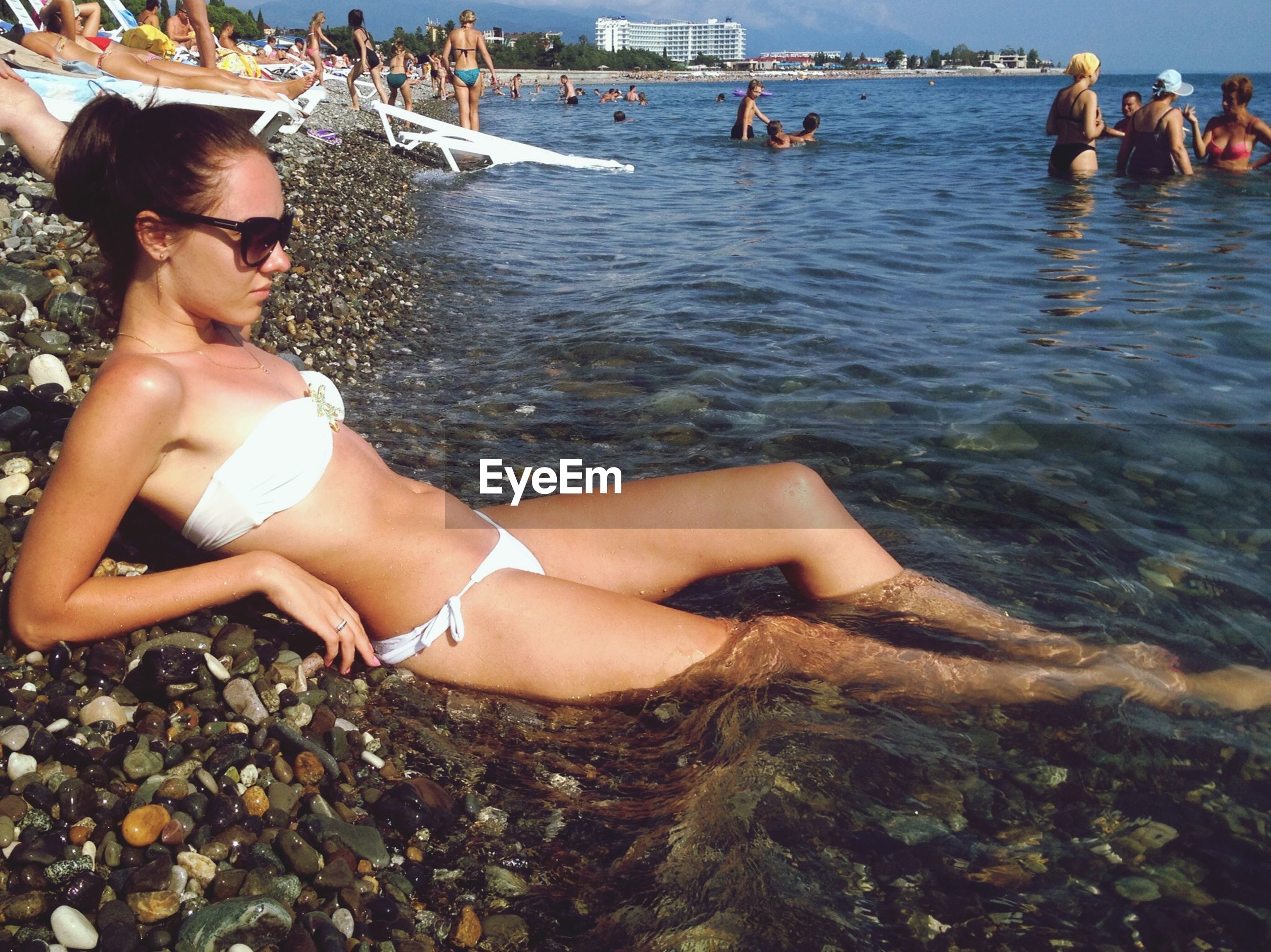 lifestyles, leisure activity, water, young women, young adult, sitting, vacations, person, relaxation, beach, sea, bikini, enjoyment, togetherness, summer, weekend activities