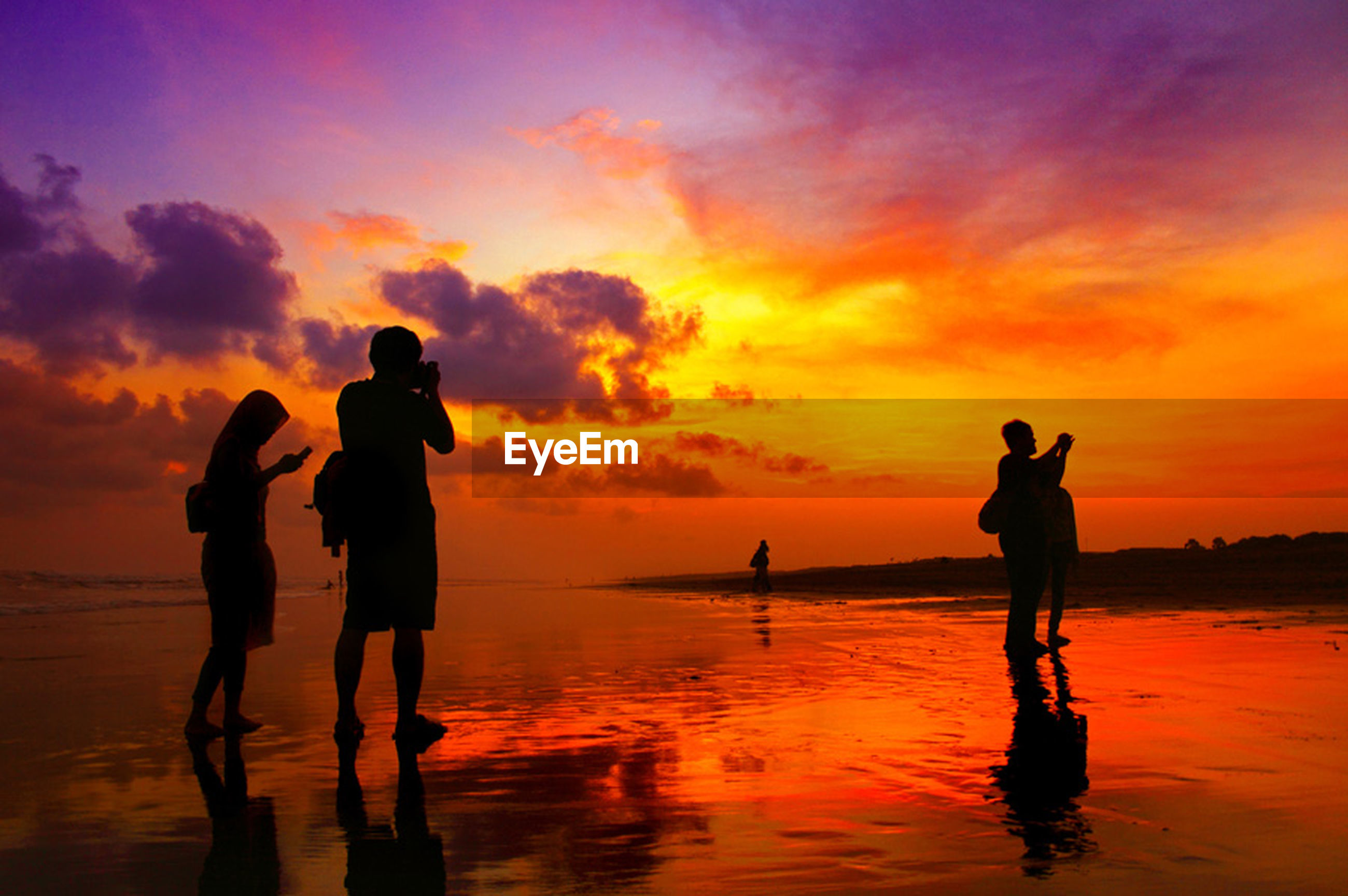 sunset, water, sea, silhouette, orange color, sky, horizon over water, beach, scenics, beauty in nature, reflection, shore, leisure activity, standing, cloud - sky, lifestyles, men, tranquility, tranquil scene