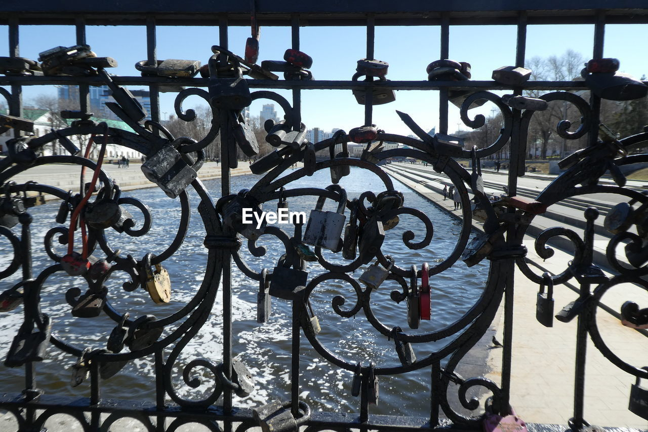 metal, no people, wrought iron, railing, safety, pattern, security, day, fence, close-up, protection, gate, barrier, design, boundary, architecture, art and craft, outdoors, metal grate, black color, iron - metal, wheel, iron