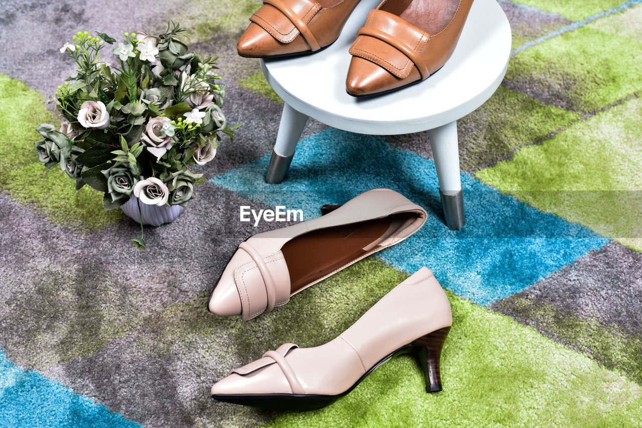 High angle view of high heels on floor