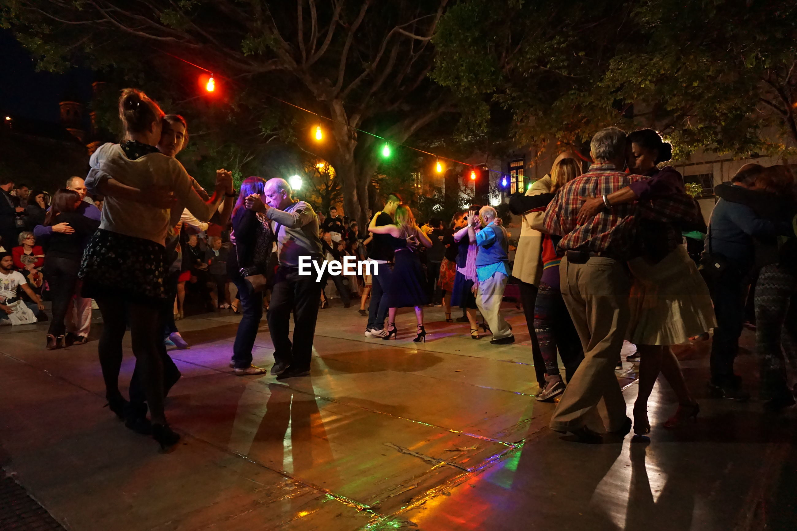 People tangoing during celebration at night