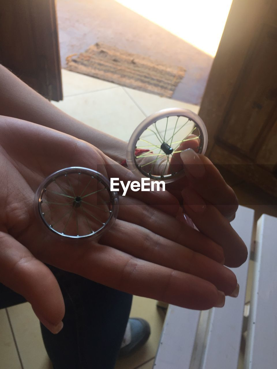 holding, human hand, hand, one person, human body part, real people, women, focus on foreground, lifestyles, nature, day, adult, plant, leisure activity, outdoors, window, glass - material, unrecognizable person, finger