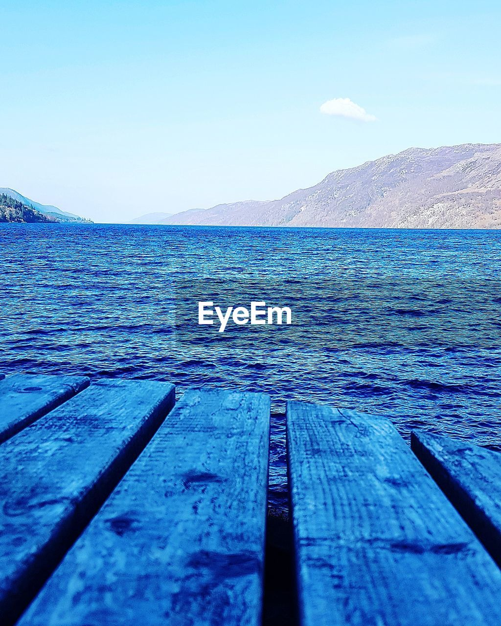 sky, water, scenics - nature, beauty in nature, wood - material, nature, blue, mountain, no people, tranquil scene, tranquility, day, sea, outdoors, pier, non-urban scene, clear sky, idyllic, surface level