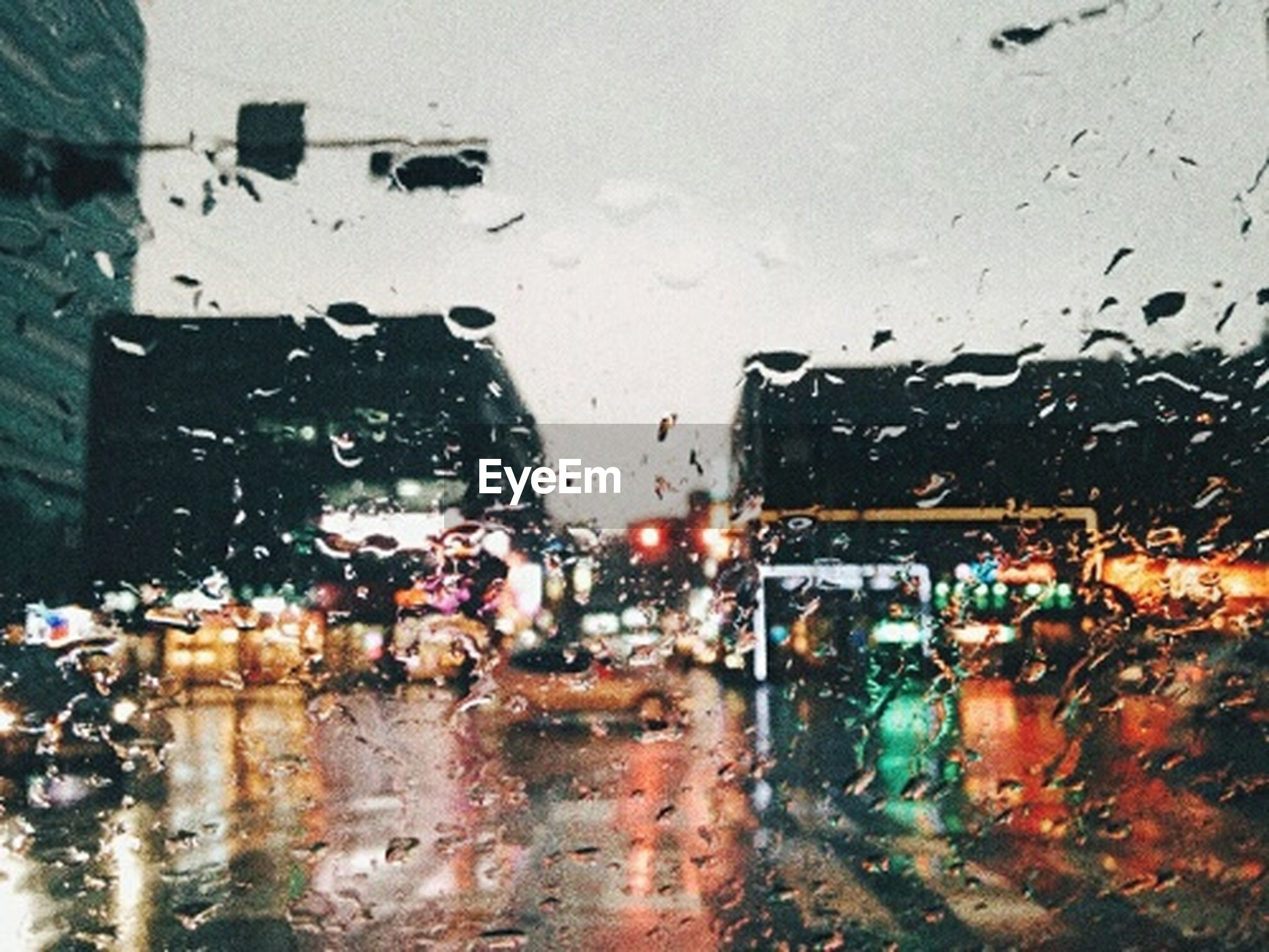 wet, rain, weather, rainy season, water, car, transportation, drop, land vehicle, raindrop, mode of transport, building exterior, close-up, road, no people, outdoors, day, architecture, sky