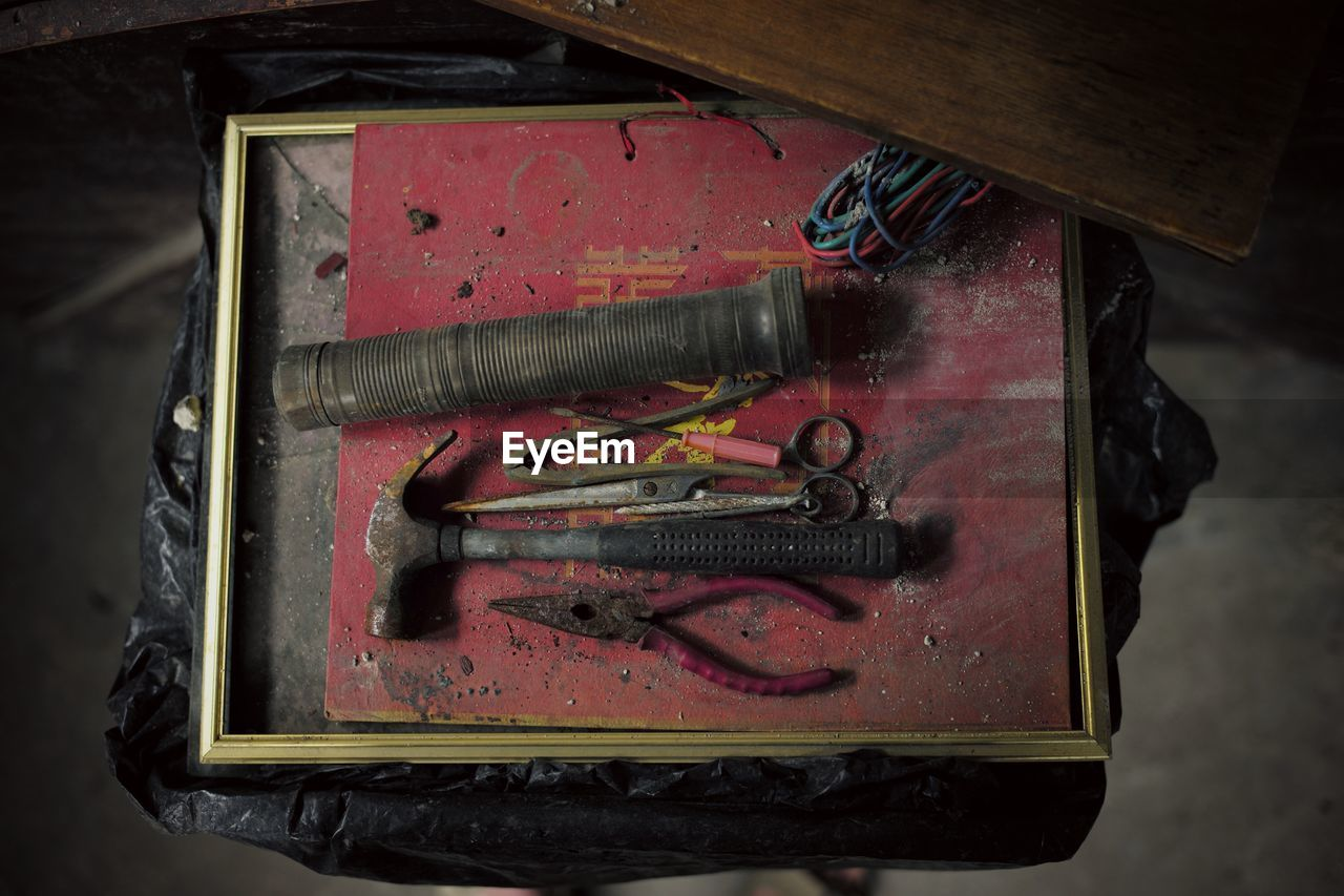 High angle view of old tools in box