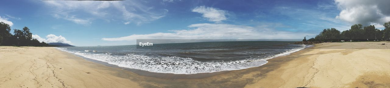 sea, beach, sand, sky, beauty in nature, scenics, nature, cloud - sky, tranquil scene, water, tranquility, horizon over water, no people, wave, outdoors, day, sunlight, panoramic, tree