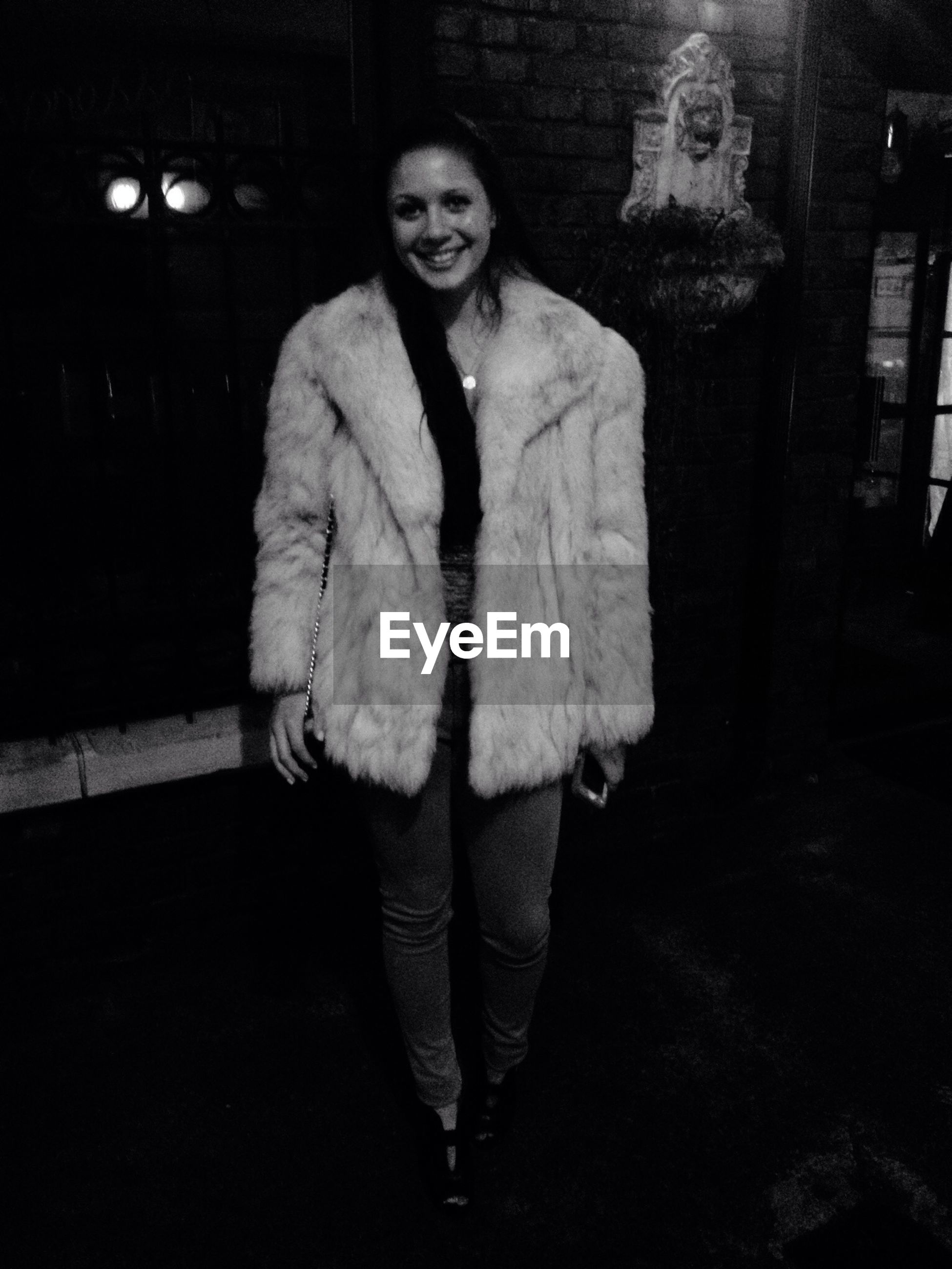 front view, casual clothing, young adult, lifestyles, person, portrait, standing, looking at camera, three quarter length, young women, leisure activity, waist up, warm clothing, jacket, full length, night
